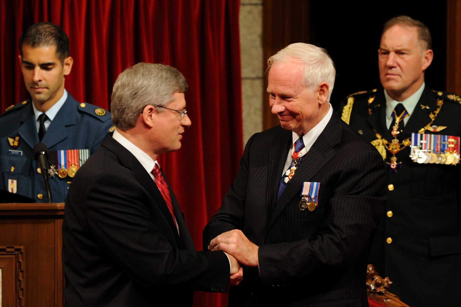 The Governor General is appointed by Her Majesty The Queen upon recommandation of the Prime Minister of Canada. The Right Honourable Stephen Harper is seen here congratulating the new Governor General.