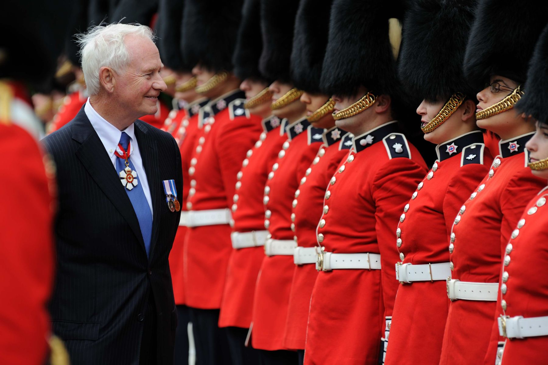 His Excellency inspected the Guard of Honour formed by the Governor General's Foot Guards and the Canadian Grenadier Guards.