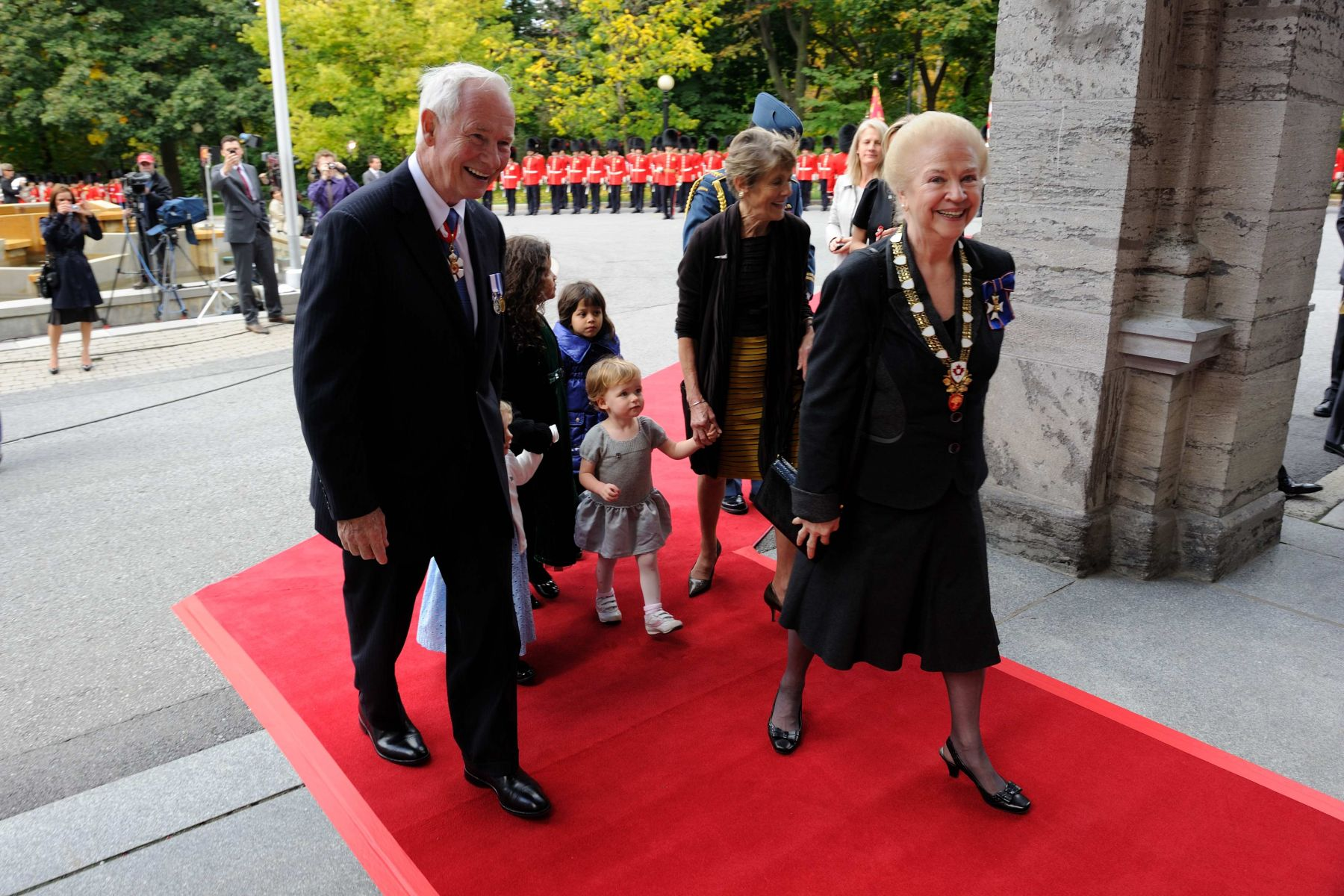 Their Excellencies then entered Rideau Hall accompanied by Mrs. Sheila-Marie Cook, Secretary to the Governor General, and their family.