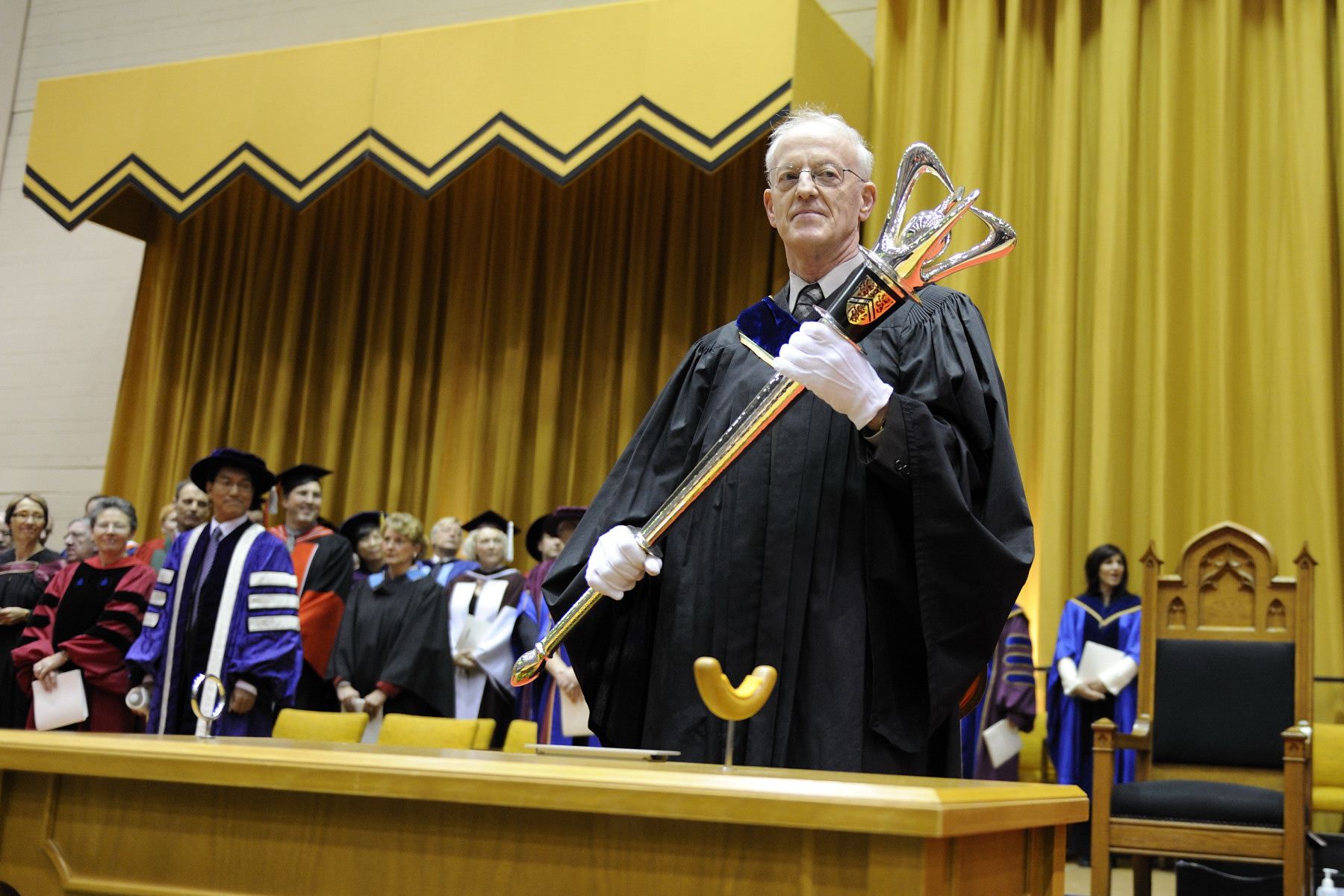 During a convocation ceremony at the University of Waterloo, in Ontario, His Excellency the Right Honourable David Johnston, Governor General of Canada, received a Doctorate of Law honoris causa from the University, and was invested as president emeritus. The University Mace Bearer marks the beginning of the ceremony.
