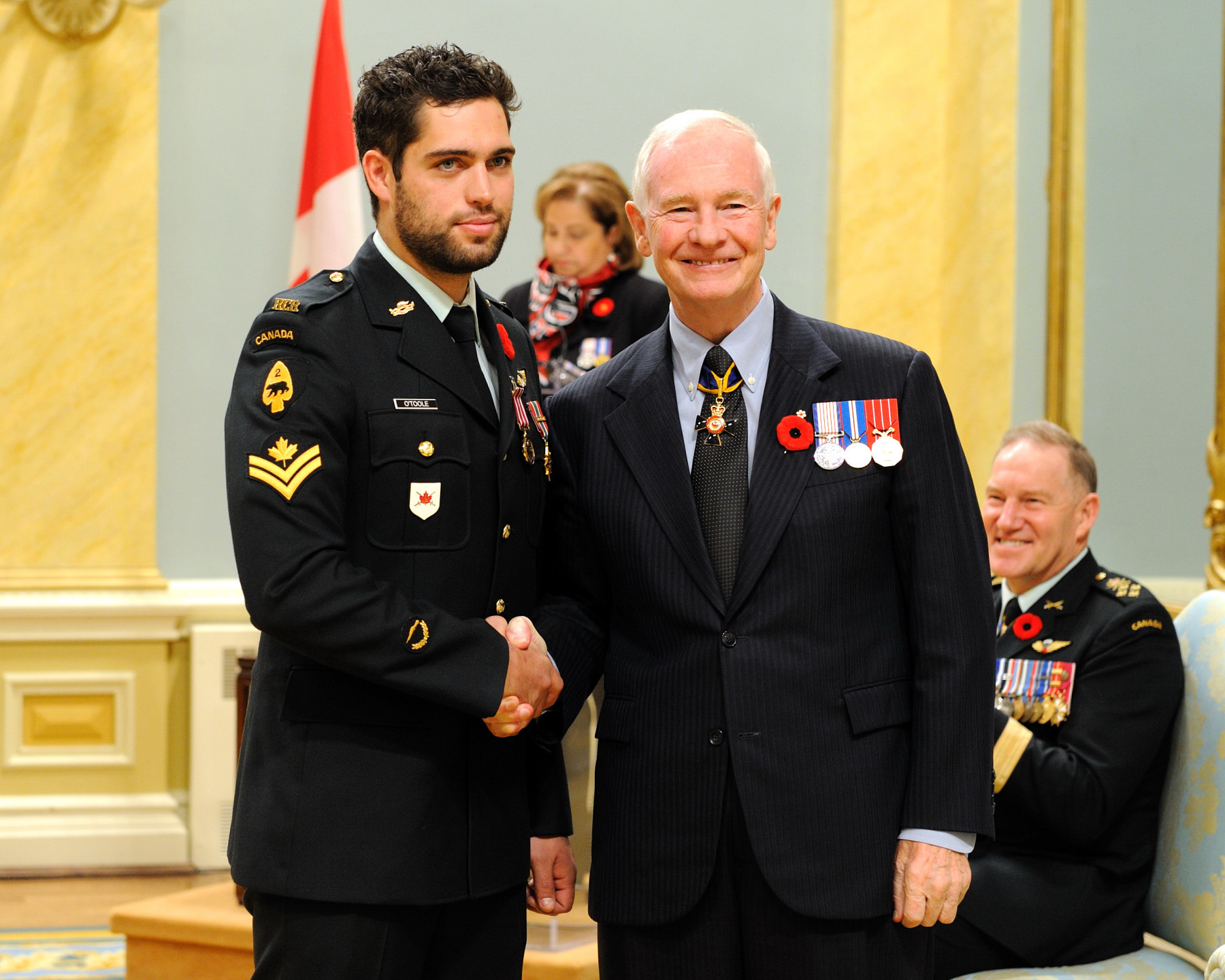 Corporal Joshua O'Toole, M.M.V., received the Medal of Military Valour from the Governor General. On October 21, 2008, Corporal O'Toole was manning the defensive tower of a combat outpost, in Afghanistan, when it was attacked by insurgents. As rounds impacted the tower and rocket-propelled grenades sailed over his head, Corporal O'Toole left the security of his location to fire an anti-armour weapon at the attackers' location. After a successful hit, he remained in a highly vulnerable position, taking up a heavy machine gun to continue returning fire. Corporal O'Toole's fearless and relentless actions suppressed the enemy, allowing friendly forces to quickly establish defensive positions and defeat the attack.