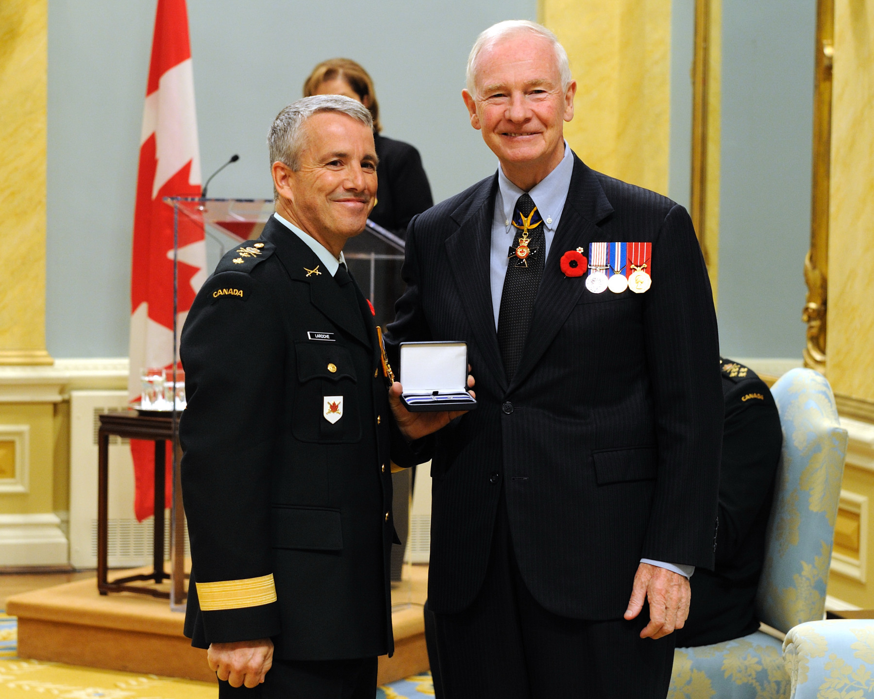 Brigadier-General Joseph René Marcel Guy Laroche, O.M.M., M.S.C., C.D., received the Meritorious Service Cross (Military Division) from the Governor General. Following the earthquake in Haiti, Brigadier-General Laroche modelled and developed an operation plan within a multinational and inter-agency framework, which quickly distinguished itself from those of the other military forces. Brigadier-General Laroche's altruism and his capacity to analyze operational issues, combined with his close collaboration with the Canadian Ambassador, the Prime Minister of Haiti, and the forces in place, enabled Canada to be one of the first countries to contribute humanitarian assistance to the Haitian people, from January to March 2010. This is the second Meritorious Service Cross for Brigadier-General Laroche.