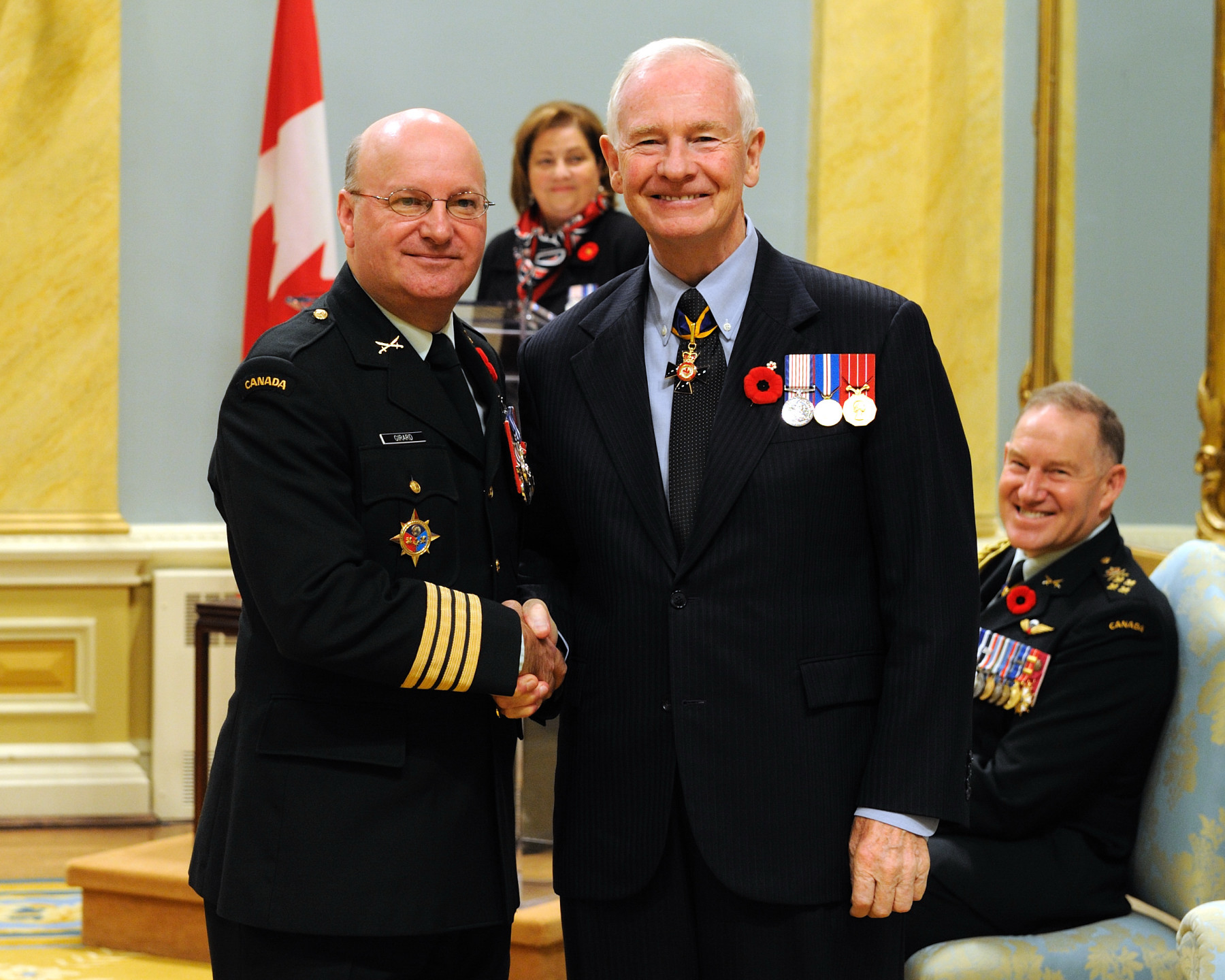 Colonel J. J. Martin Girard, M.S.M., C.D., received the Meritorious Service Medal (Military Division) from the Governor General. Colonel Girard was deployed to Haiti as the commander of Task Force Port-au-Prince from July 2008 to August 2009. Occupying a senior leadership role as the chief of staff to the United Nations force commander, he established relationships with key stakeholders that facilitated the operations of the international stabilization mission. His outstanding coordination of 7 000 multinational soldiers and interaction with international aid agencies enabled an organized relief effort during Haiti's hurricane crisis, played a prominent role in supporting senatorial elections and led to the implementation of a quick-reaction force that quickly quelled rioting in the country.