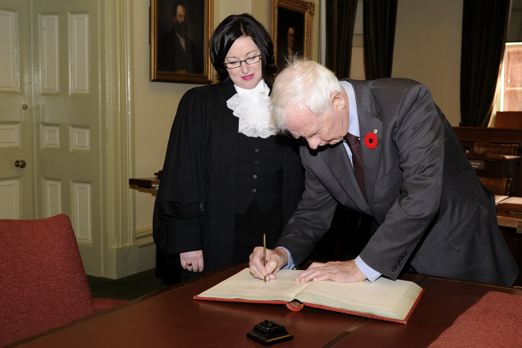 In the presence of the Speaker of the Legislative Assembly, His Excellency signed the guest book in the Legislative Chamber.