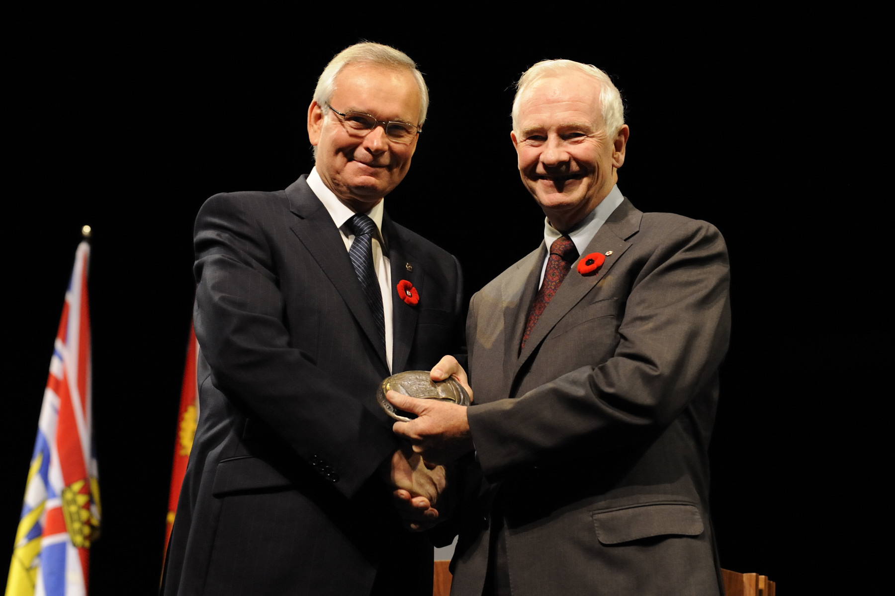 His Excellency received the Confederation Centre of the Arts' Symons Medal from the master of ceremonies Mr. Wayne Hambly.