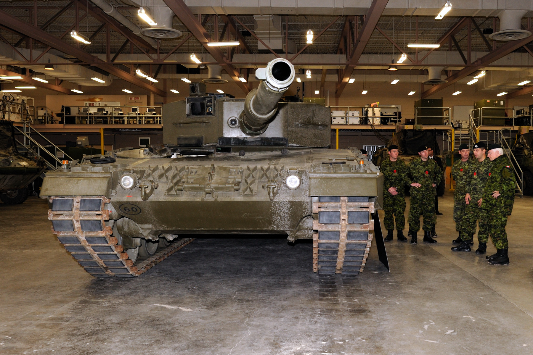 His Excellency is shown and explained the purpose of a Leopard Tank.