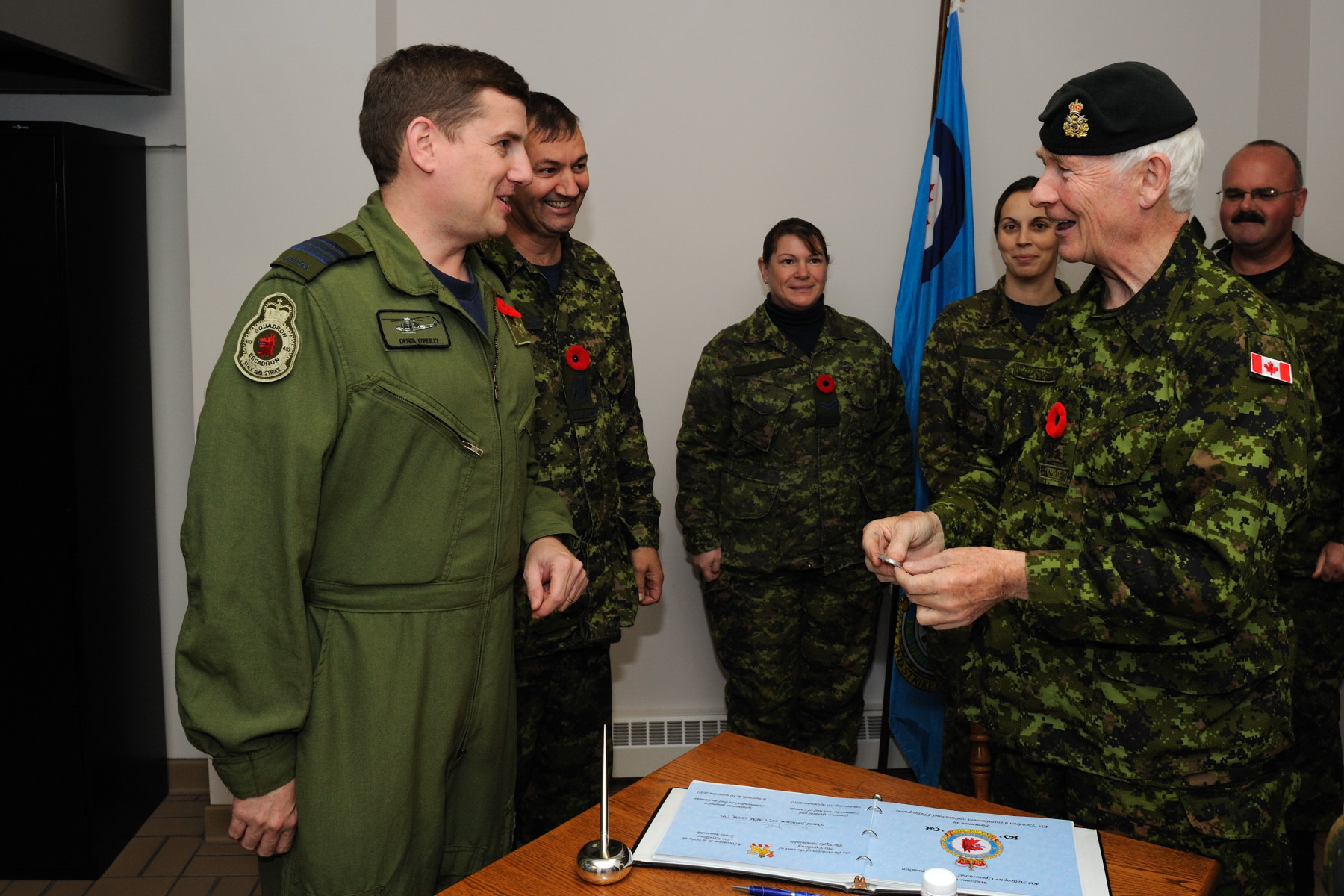 His Excellency received a 403 Squadron unit coin.