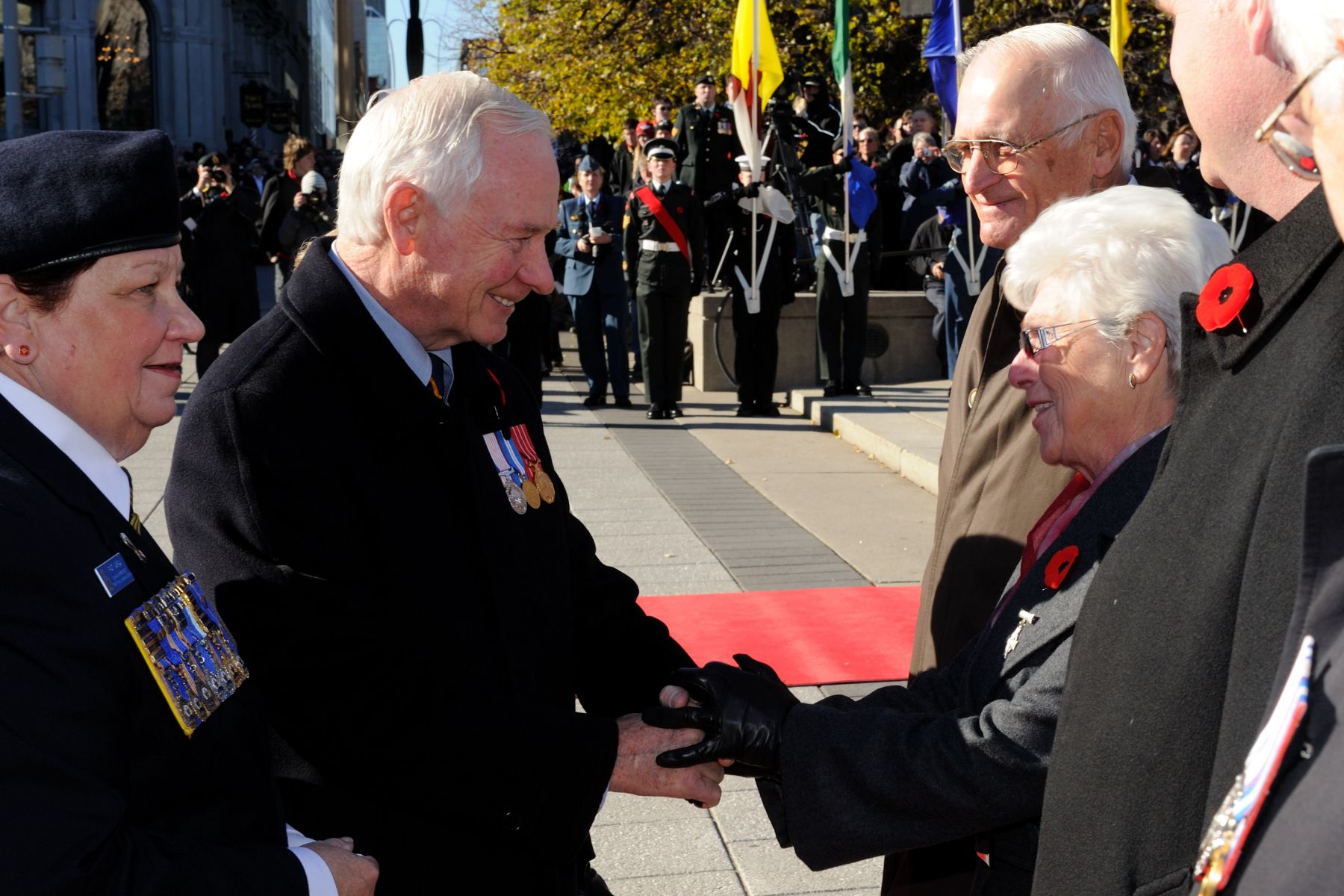 He was then introduced to the 2010 Silver Cross Mother, Mrs. Mabel Girouard. By attending the National Remembrance Day Ceremony in Ottawa, Mrs. Girouard represented all Canadian mothers who have lost children in the military service to their nation.