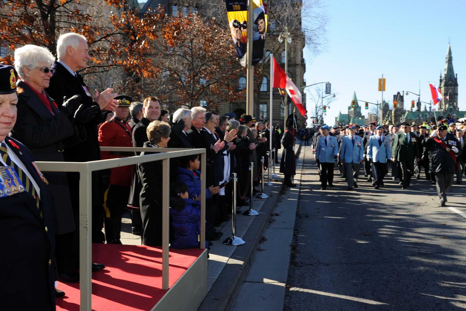 The Governor General invited the Silver Cross Mother to stand beside him during the march past.