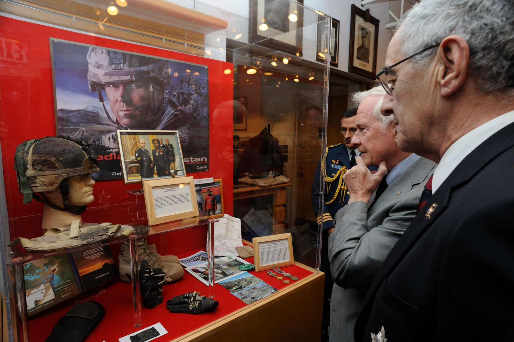 In the Regimental museum, His excellency looked at a display honouring Corporal John David Makela, M.M.V., from Ottawa, Ontario, who received the Medal of Military Valour. On October 16, 2006, Corporal Makela prevented a fatal attack on his combat logistics patrol by a suicide bomber in Afghanistan. The explosion engulfed Corporal Makela's vehicle and seriously burned him. His valiant and courageous actions inevitably prevented the bomber from reaching his intended target and saved the lives of the other soldiers in the convoy.