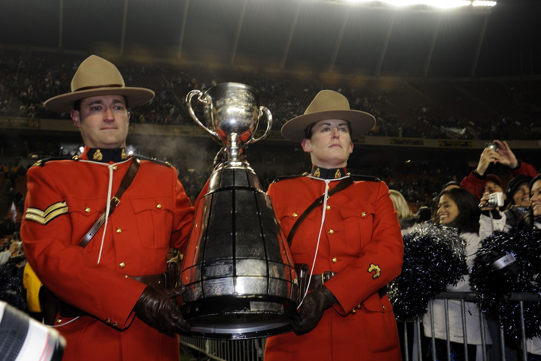The trophy was carried by two RCMP officers. In 1909, Governor General Earl Grey donated a trophy for the Rugby Football Championship of Canada. The trophy, which subsequently became known as the Grey Cup, was originally open only to teams that were registered with the Canada Rugby Union. Since 1954, only the teams of the CFL have participated in the challenge for the Grey Cup.