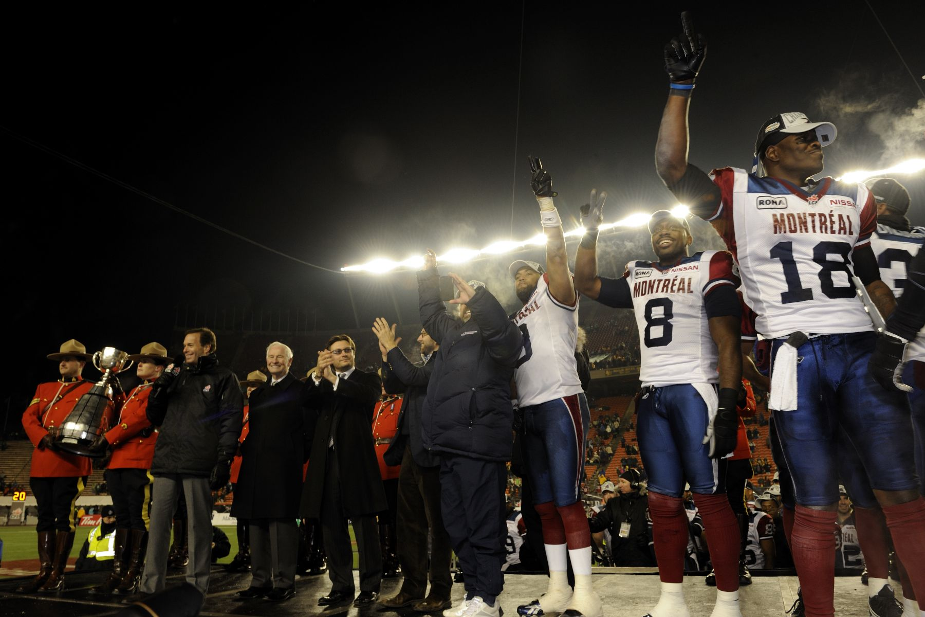 Players from the Montréal Alouettes are celebrating their victory.