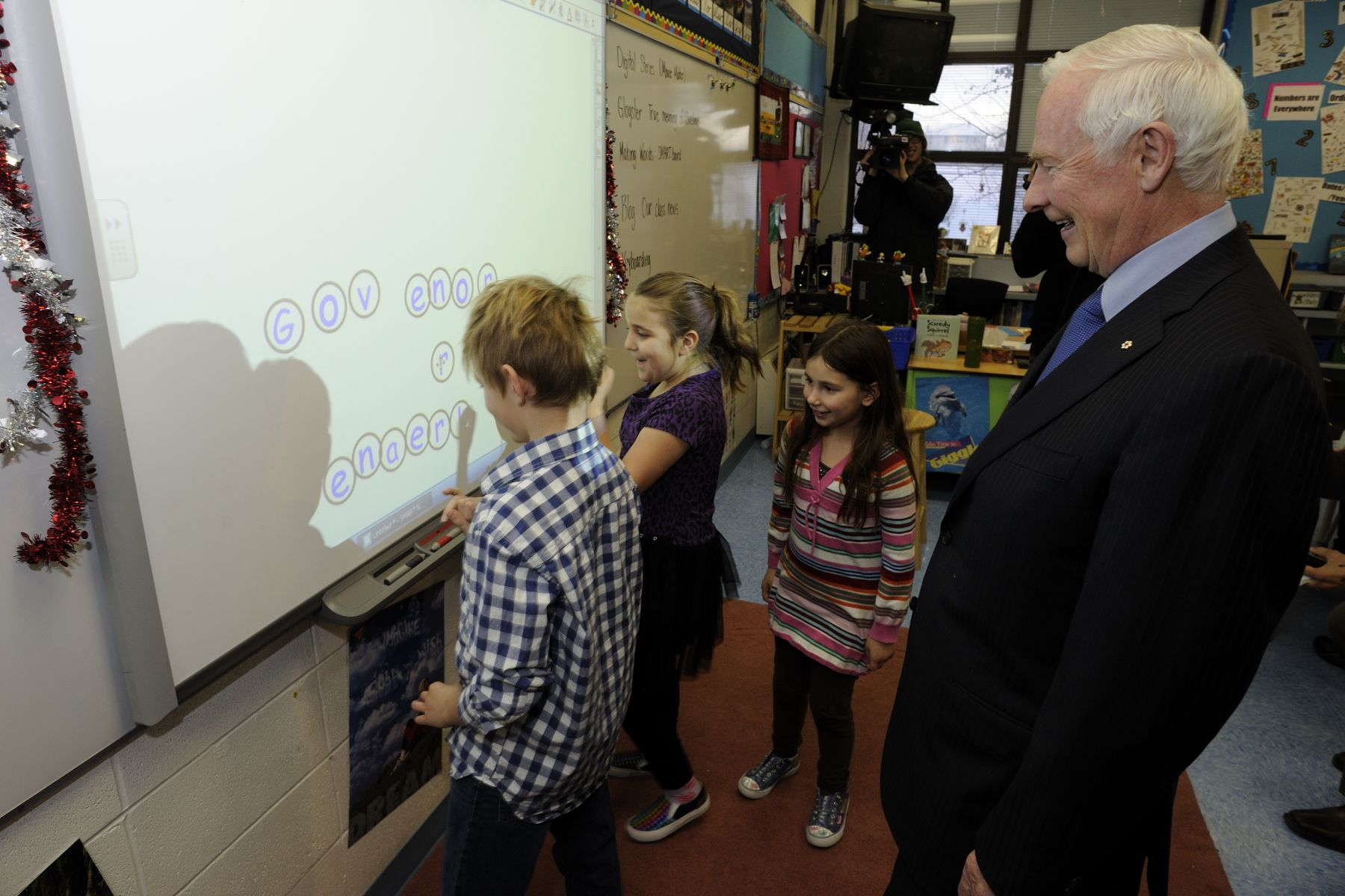 The school uses video games and video boards in classrooms to educate students from Grades 2 to 6.
