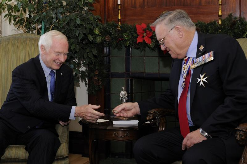 The Lieutenant Governor is showing His Excellency the coin he tossed at the 98th Grey Cup Championship on November 28, 2010.