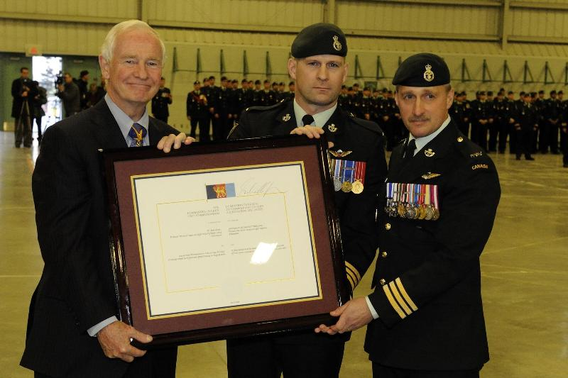 The Governor General presented the scroll to LCol Fletcher (left) and LCol Hope (right). The Commander-in-Chief Unit Commendation was created on July 3, 2002, to recognize outstanding service by units of the Canadian Forces in extremely hazardous circumstances in an active theatre of operations.
