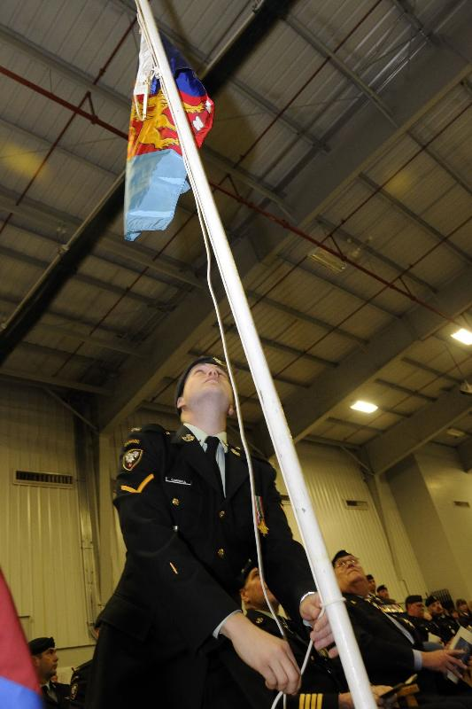 "The Commander-in-Chief Unit Commendation was presented to the 1st Battalion of the PPCLI Battle Group ""For exceptional determination and courage during relentless combat in Afghanistan, from January to August 2006."" Private Campbell raises the flag."