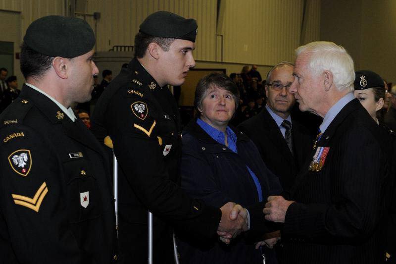 His Excellency spoke to members of the Battalion. Here, he speaks with Private Ginther.
