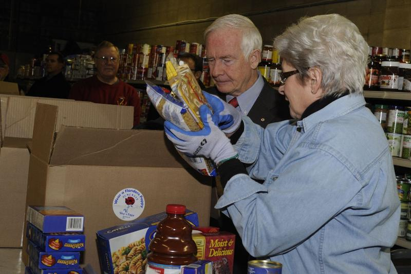 During a visit to the Calgary Poppy Fund Headquarters, His Excellency the Right Honourable David Johnston, Governor and Commander-in-Chief of Canada, helped pack a food hamper going to veterans.