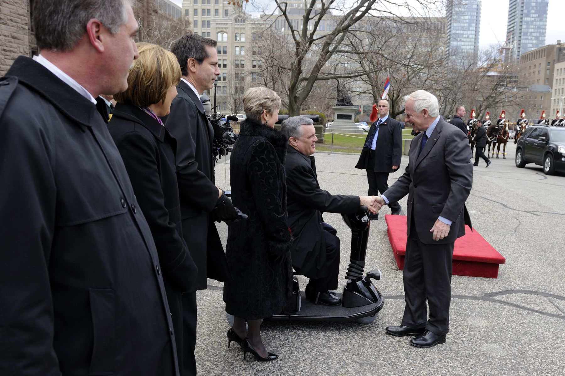 Upon his arrival at the Legislative Building at Queen's Park, His Excellency was greeted by His Honour David C. Onley, Lieutenant Governor of Ontario.