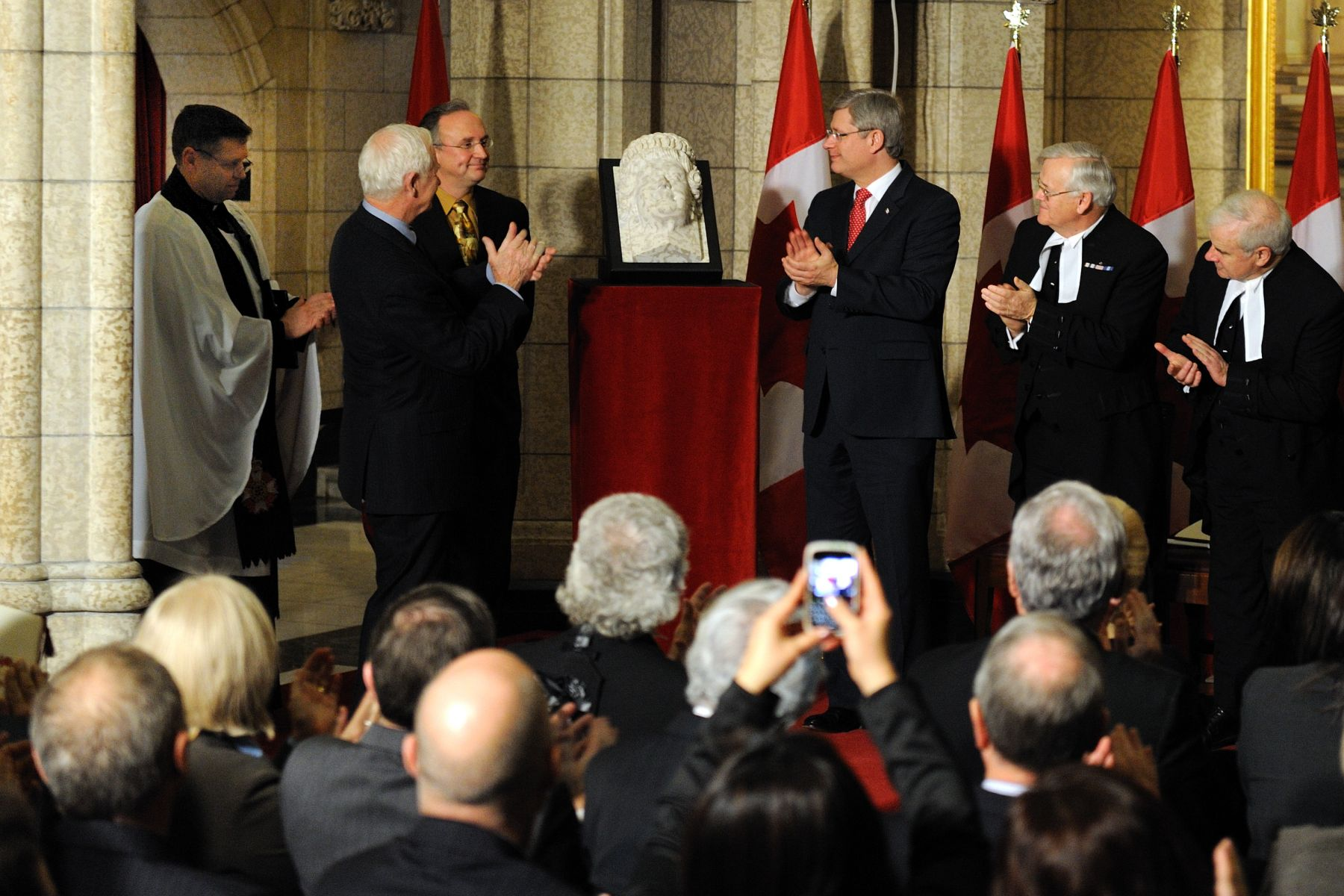 His Excellency the Right Honourable David Johnston, Governor General of Canada, and the Right Honourable Stephen Harper, Prime Minister of Canada, unveiled the sculptured corbel of Her Majesty Queen Elizabeth II during a ceremony in the Senate Foyer, on December 9, 2010. The corbel was created by Dominion Sculptor Phil White and commissioned for the Diamond Jubilee of Her Majesty as Queen of Canada, which will be celebrated on February 6, 2012.