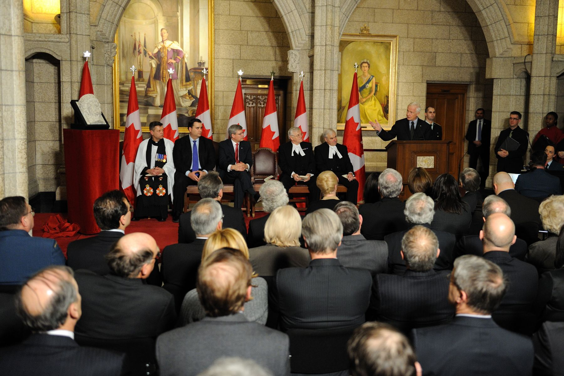 The maquette of the sculptured corbel was first unveiled by Her Majesty The Queen at a ceremony at Rideau Hall, on June 30, 2010, as part of her Royal Tour of Canada.