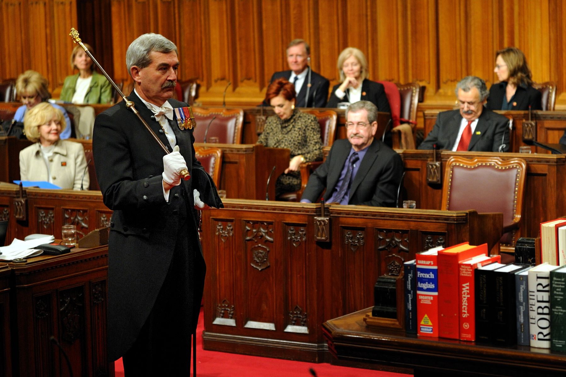 Royal Assent is granted by a representative of the Crown to approve a bill passed by the House of Commons and the Senate, making it into an Act of Parliament. Royal Assent is therefore the last stage in the legislative process and assembles the three constituent entities of Parliament (Crown, Senate, House of Commons).