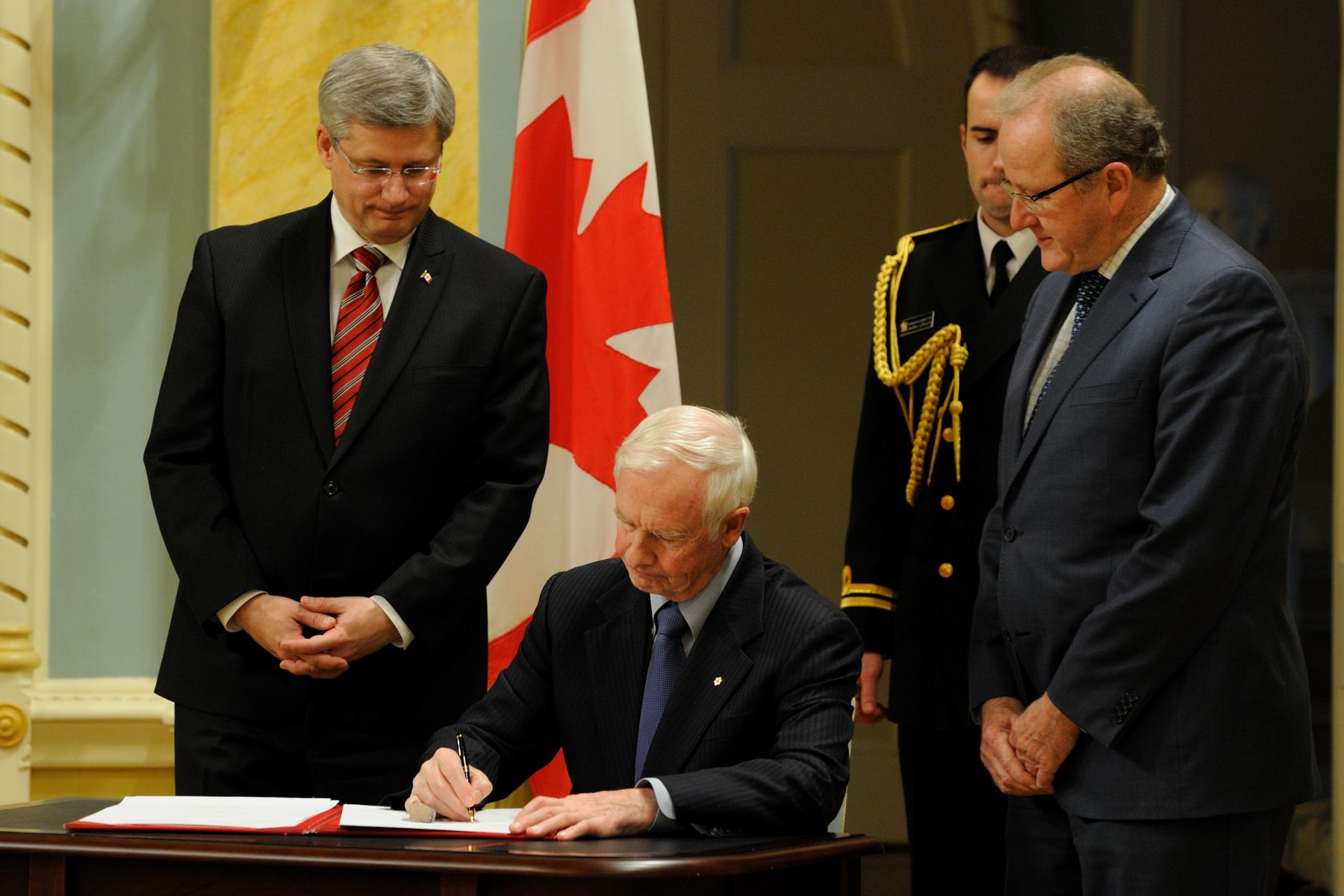 Governor General David Johnston, Prime minister Stephen Harper and Clerk of the Privy Council Mr. Wayne G. Wouters signed the Privy Council Oath Book.