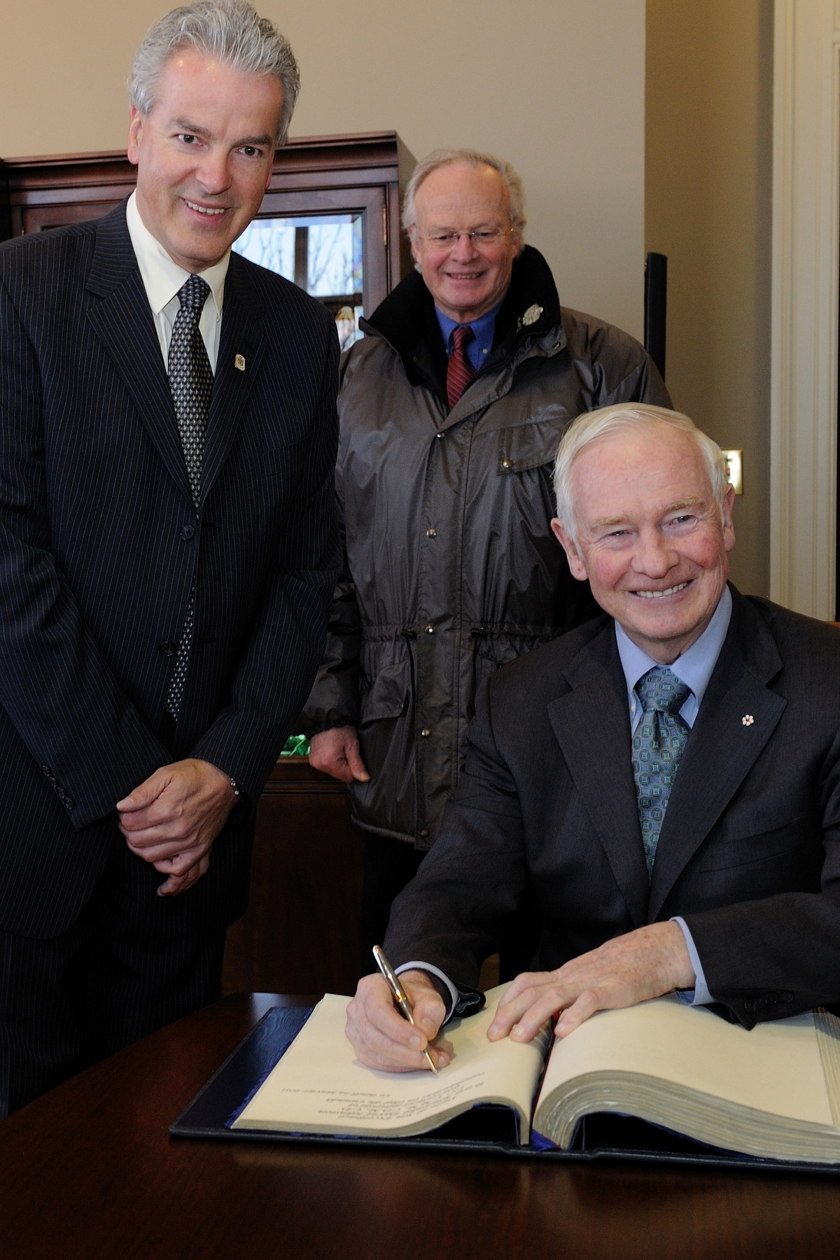 During his visit to City Hall, the Governor General signed the guest book.