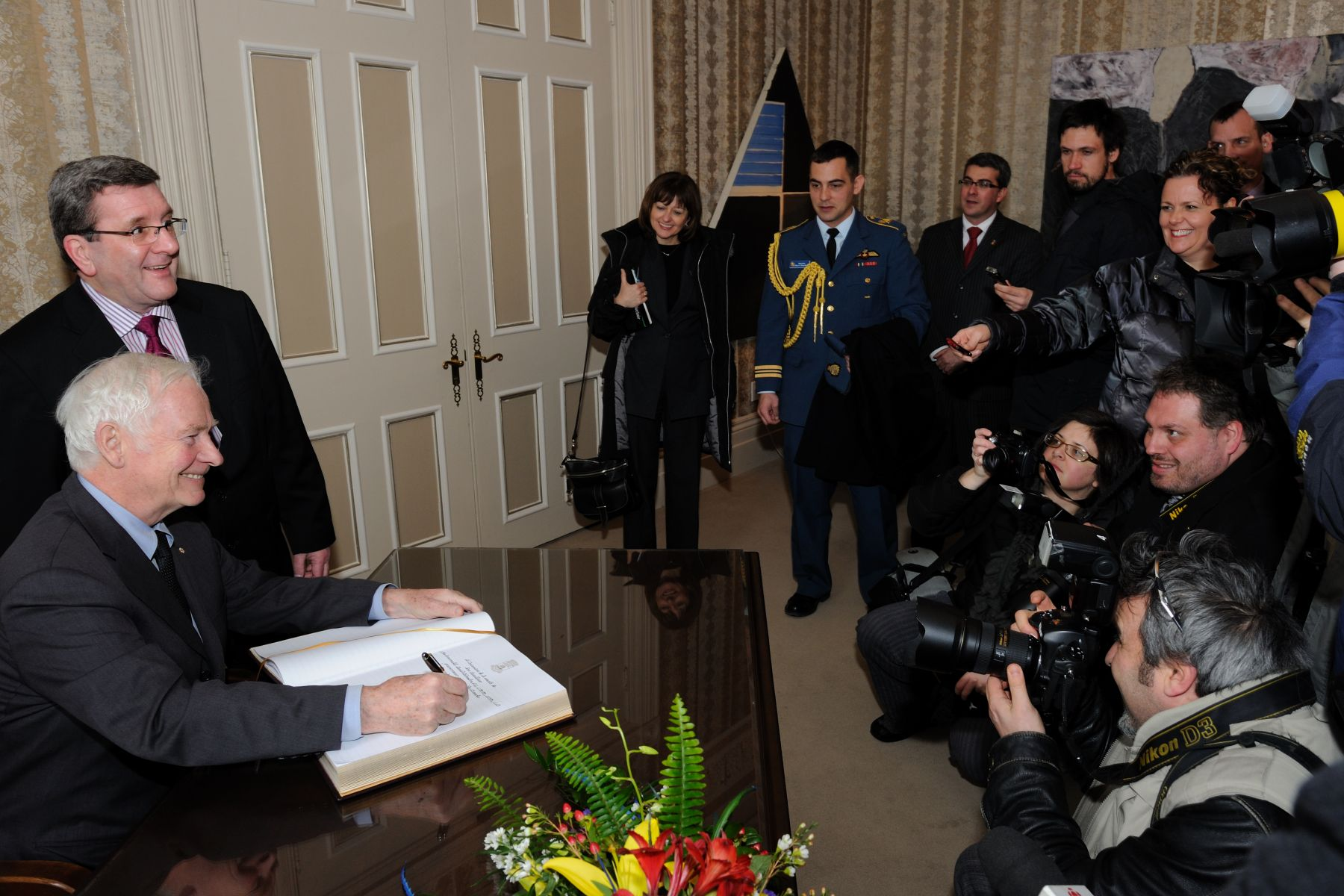 In front of media, the Governor General signed the guest books.