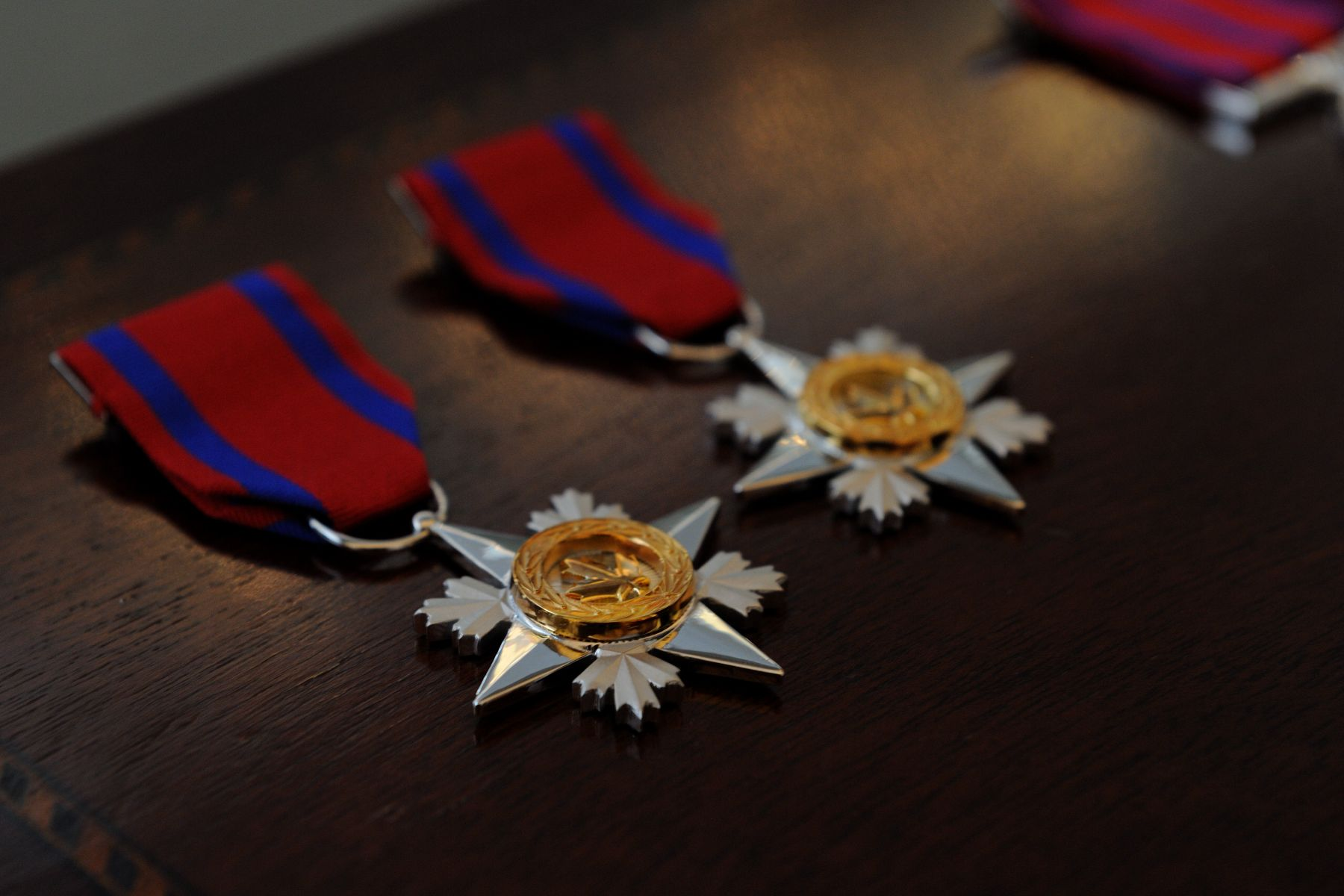 The Decorations for Bravery were created in 1972, to recognize people who risked their lives to try to save or protect the lives of others. The Cross of Valour (C.V.) recognizes acts of the most conspicuous courage in circumstances of extreme peril; the Star of Courage (S.C.) recognizes acts of conspicuous courage in circumstances of great peril; and the Medal of Bravery (M.B.) recognizes acts of bravery in hazardous circumstances.