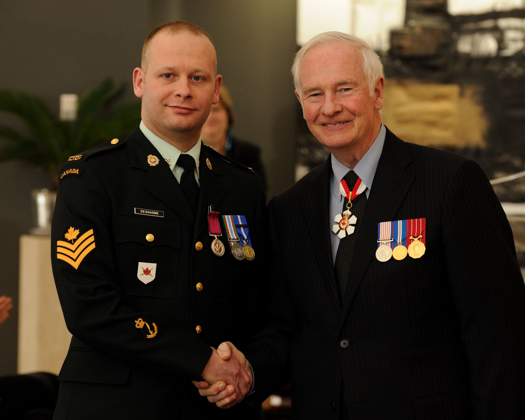On August 16, 2008, Sergeant Steve Desgagné, M.B., an off-duty member of the Canadian Forces, prevented a man from committing an armed robbery and possibly harming a store clerk, at a convenience store in Montréal. The man had approached the clerk, held up a knife, and told him that this was a holdup. When Sergeant Desgagné noticed the robbery in progress, he put his hand in his pocket and pretended that he had a gun. Approaching the individual, Sergeant Desgagné ordered him to put down his knife. The robber dropped his weapon and started to flee. Sergeant Desgagné ran after the man, not knowing if he carried another weapon. After a brief struggle, the robber was subdued and held until the police arrived.