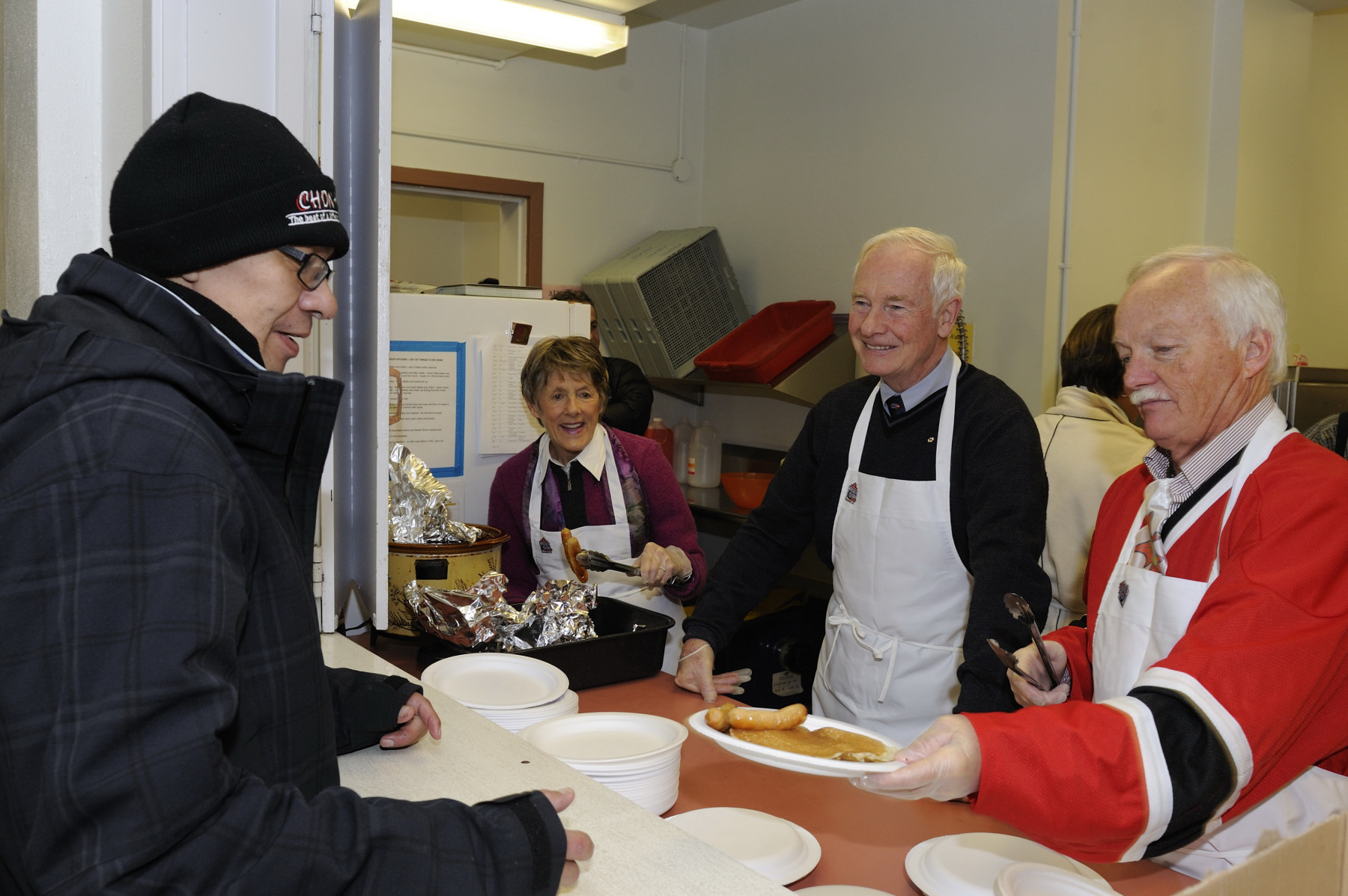 On the final day of their official visit to Yukon, Their Excellencies, accompanied by the Honourable Douglas George Phillips, attended a community pancake breakfast, in Whitehorse, hosted in honour of the 11th annual Hockey Day in Canada.