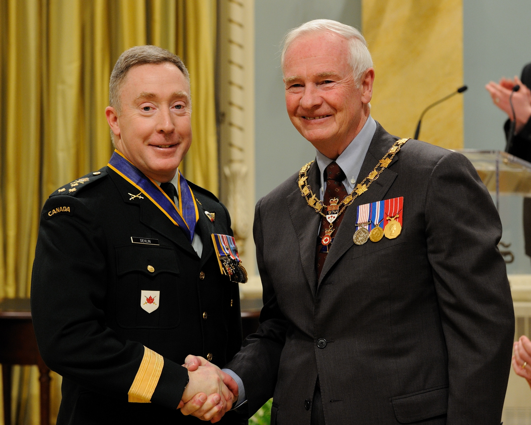 His Excellency presented the Order of Military Merit at the Commander level (C.M.M.) to Major-General Peter Devlin, C.M.M., M.S.C., C.D., Canadian Expeditionary Force Command Headquarters, Ottawa, Ontario. This is a promotion within the Order.
