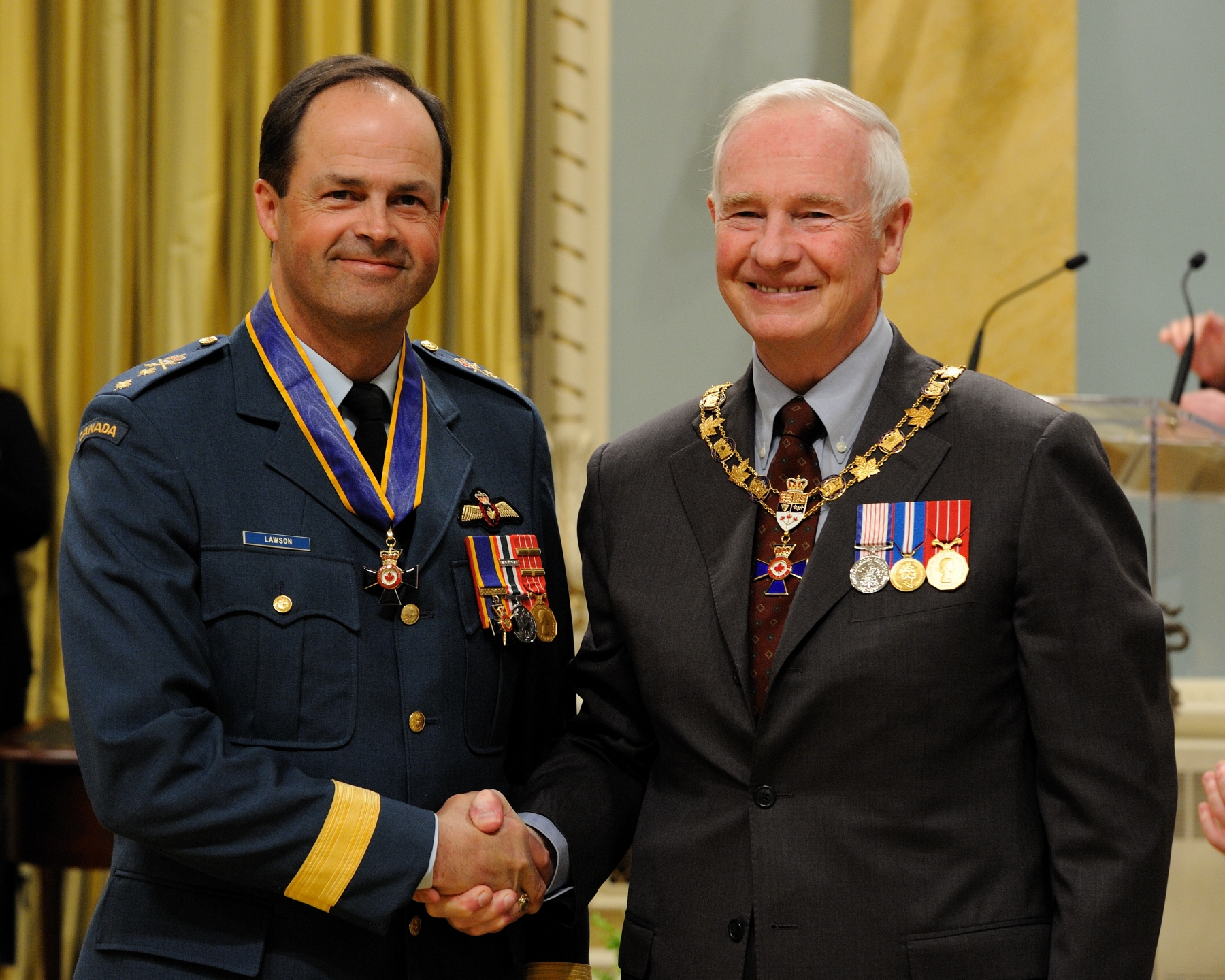 His Excellency presented the Order of Military Merit at the Commander level (C.M.M.) to Major-General Thomas James Lawson, C.M.M., C.D., Office of Chief of the Air Staff, Ottawa, Ontario. This is a promotion within the Order.