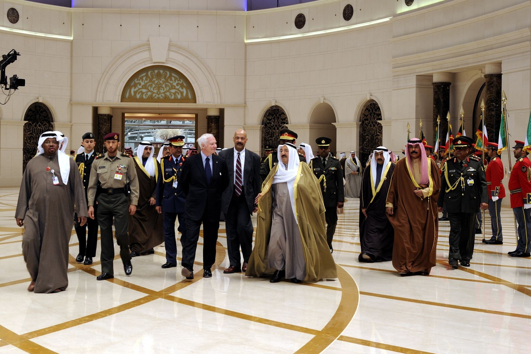 His Excellency is accompanied by His Highness Sheikh Sabah Al-Ahmad Al-Jaber Al-Sabah, the Amir of Kuwait, during the official welcoming ceremony with Guard of Honor at the Amiri Air Terminal, Kuwait International Airport.