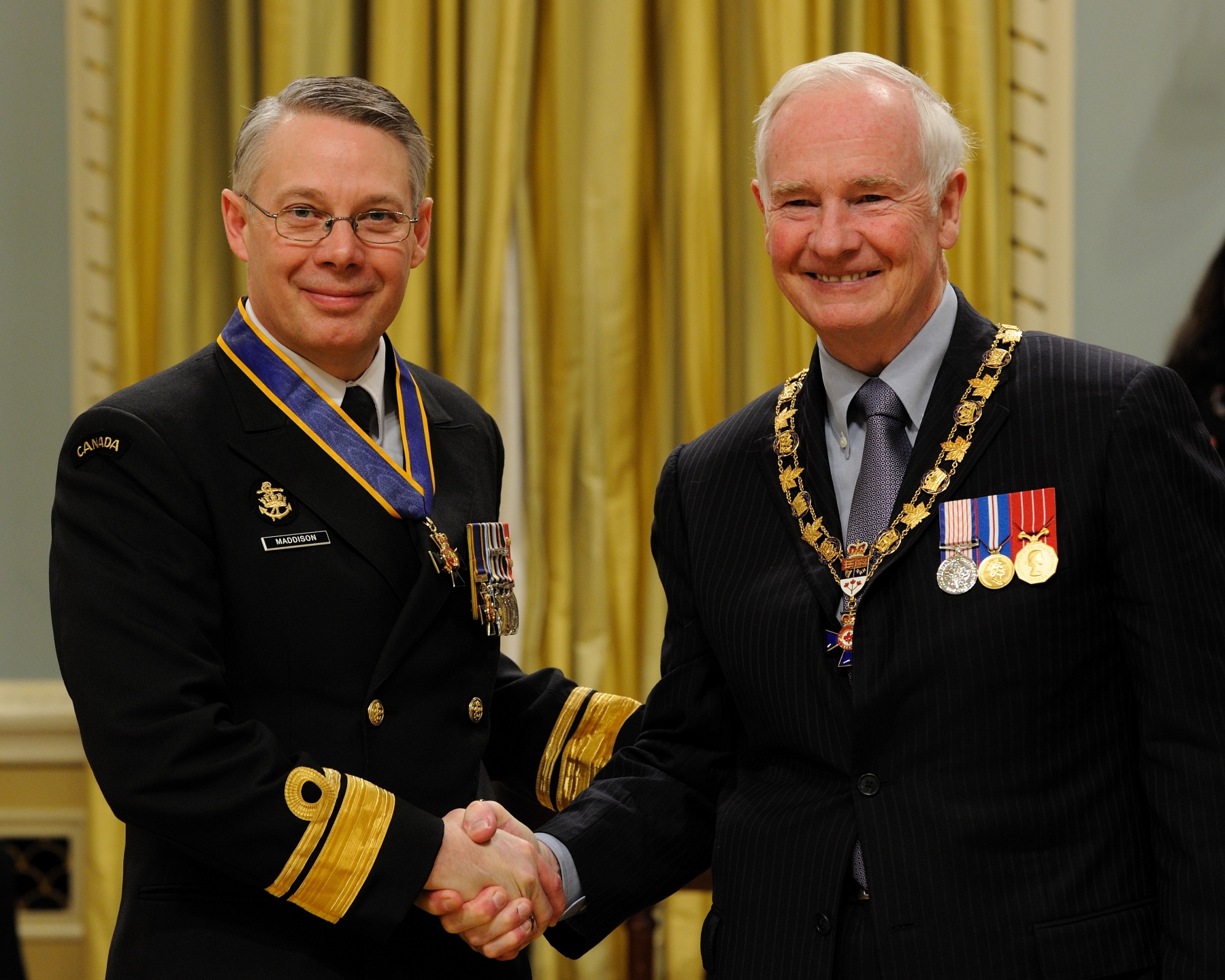 His Excellency presented the Order of Military Merit at the Commander level (C.M.M.) to Rear-Admiral Paul Andrew Maddison, C.M.M., M.S.M., C.D., Office of Chief of the Maritime Staff, Ottawa, Ontario. This is a promotion within the Order.
