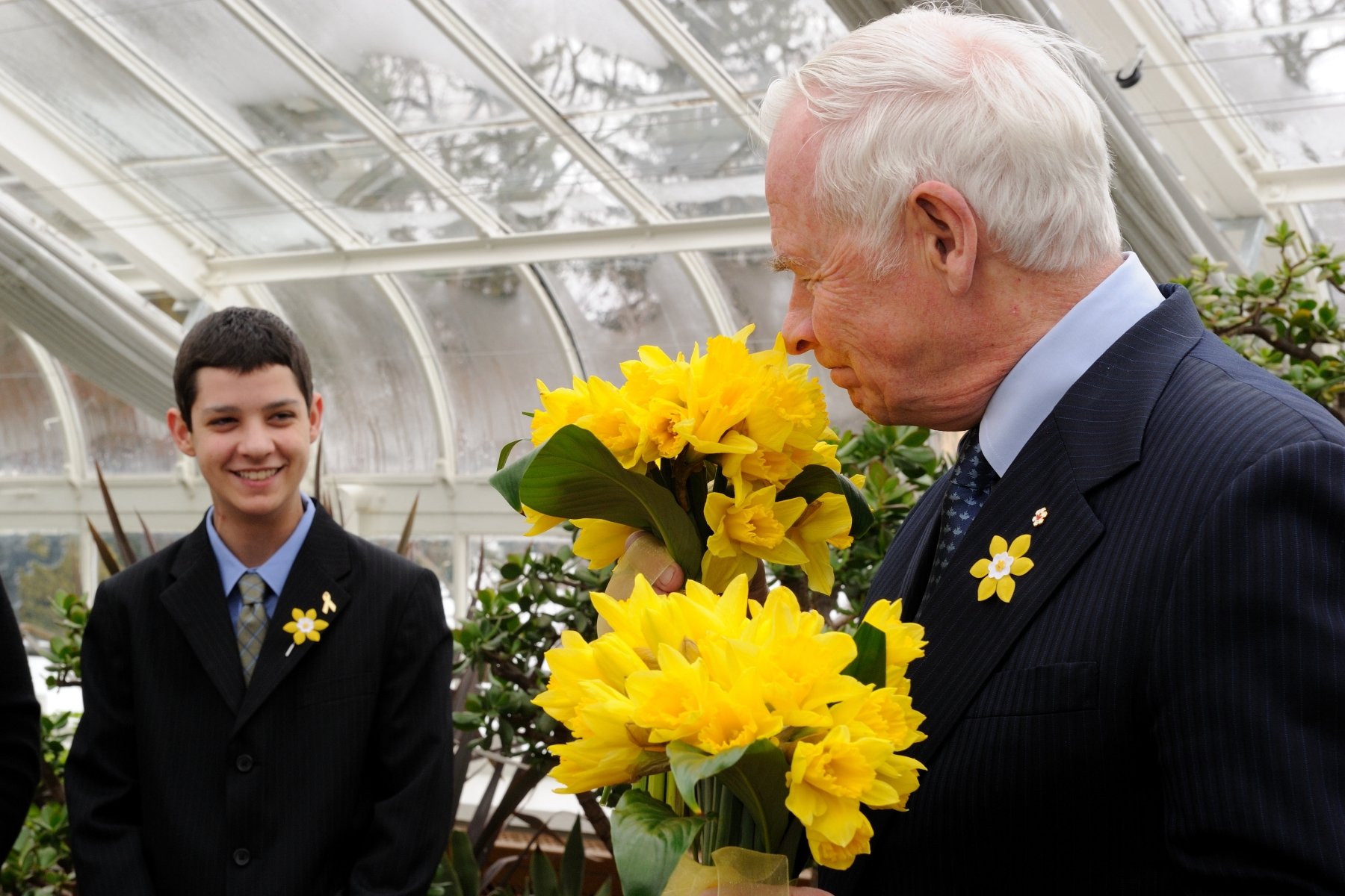 His Excellency took a few moments to appreciate the fragrant bouquet of daffodils.