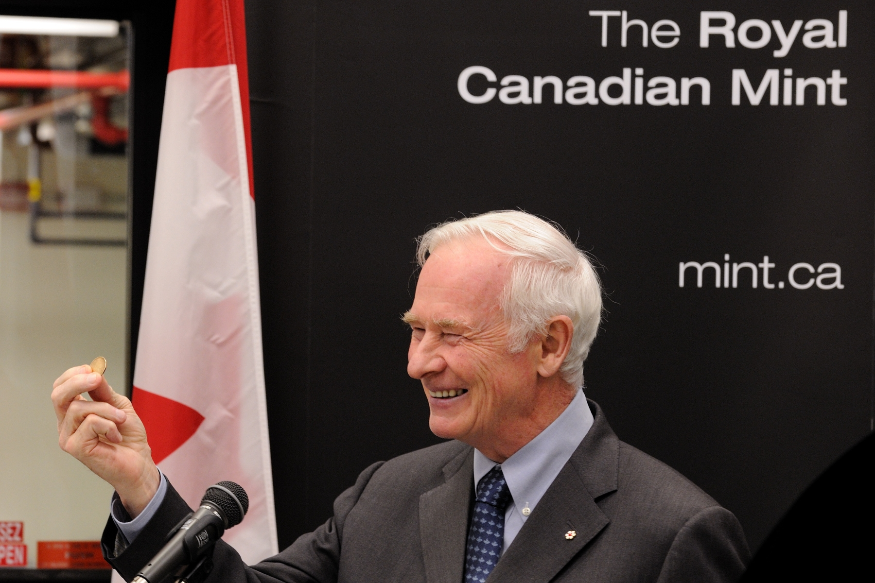 "His Excellency the Right Honourable David Johnston, Governor General of Canada, attended the unveiling of two Royal Wedding coins at the Royal Canadian Mint. For this special occasion, the Governor General delivered a speech: ""It is a pleasure to be with you here today for the unveiling of two commemorative coins in honour of the upcoming Royal Wedding of His Royal Highness Prince William and Miss Catherine Middleton. It is also my pleasure to strike one on this occasion, as past governors general have done. This wedding is also an opportunity to renew our commitment to the Crown and to celebrate our rich history."""