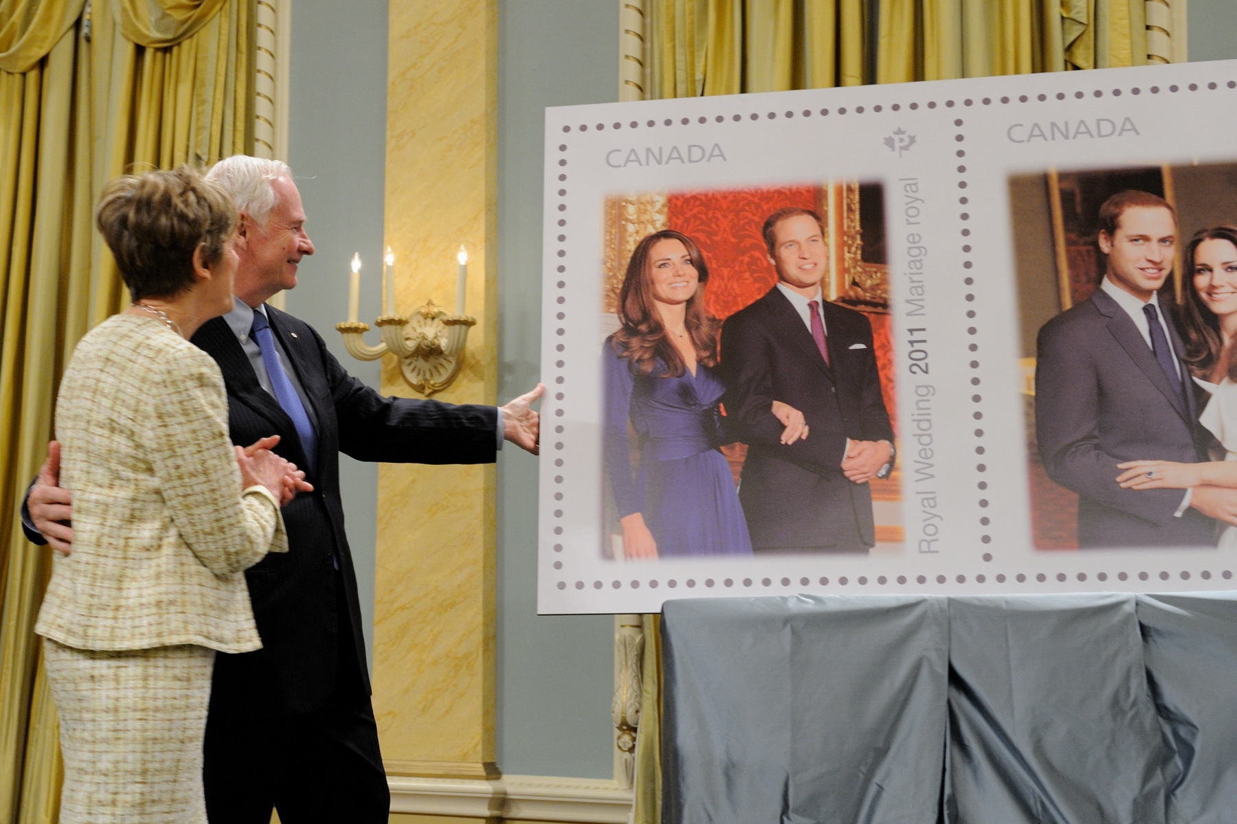 The new stamps feature photographs of the Royal Couple and were personally approved by His Royal Highness Prince William and Her Majesty The Queen. The domestic stamp shows a photo of the couple when they announced their engagement last November, and the international rate stamp bears the official engagement portrait taken by famed photographer Mario Testino.