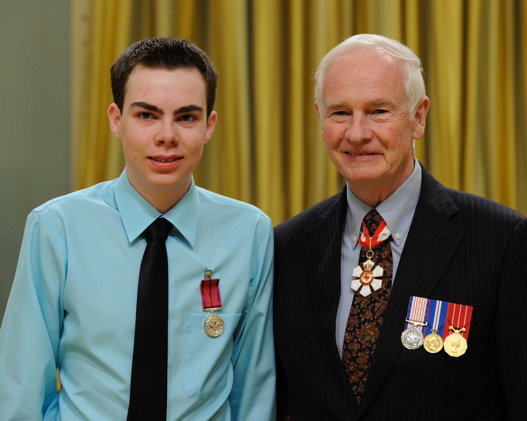 On January 31, 2009, 14-year-old Scott Borlase, M.B., was instrumental in keeping his sister safe during a snowstorm on Lake Winnipeg, in Manitoba. Scott, his 11-year-old sister, and their father had started their snowmobile outing on a clear morning, but by early afternoon the weather had changed. They lost sight of the marked trail due to the severe winds and heavy snowfall. At one point, Scott's father got off the snowmobile and collapsed to the ground. Unable to find a pulse, Scott made the decision to go for help with his sister. In the blinding storm, Scott drove in a straight line hoping to eventually reach the shoreline. Once at the shore, Scott was able to use his cell phone to call 911 and provide directions to their location. He brought his sister into a bush area away from the biting wind, and used a solar blanket to keep them warm until help finally arrived several hours later. Another search party located his father who, sadly, did not survive.