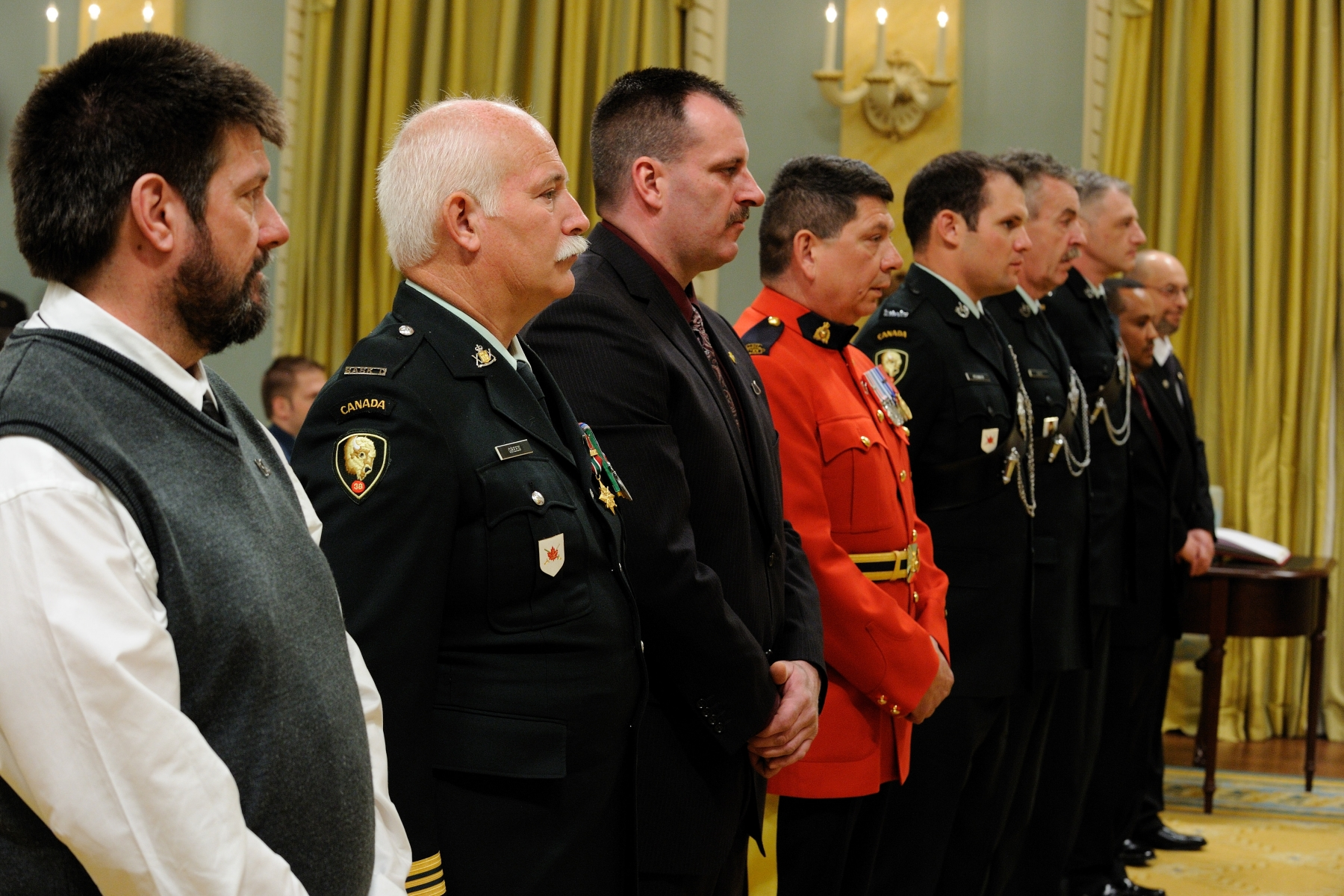 On October 12, 2007, Major William Green, M.B., C.D., Warrant Officer Shaun Spence, M.B., C.D., Sergeant Joseph Penman, M.B., Roland Bouliane, M.B., and Abebe Yohannes, M.B., rescued two people who were trapped inside burning vehicles, in Headingly, Manitoba. The men tried frantically to put out the fire inside one vehicle, but the flames spread quickly and the dark smoke made it difficult to see inside. Major Green broke the rear window, pulled a little girl from the back seat and brought her to safety. Constable Alfred Lavallee, M.B., C.D., and the other rescuers again tried desperately to reach the two other victims inside, but were driven back by the heat and flames. Meanwhile, Blair Hockin, M.B., Hermann Zarbl, M.B., and Master Warrant Officer Hamish Seggie, M.B., C.D., ripped out parts of the dash on the second vehicle to pull out the driver, who was trapped beneath the debris. They removed the victim, moments before the vehicle became engulfed.
