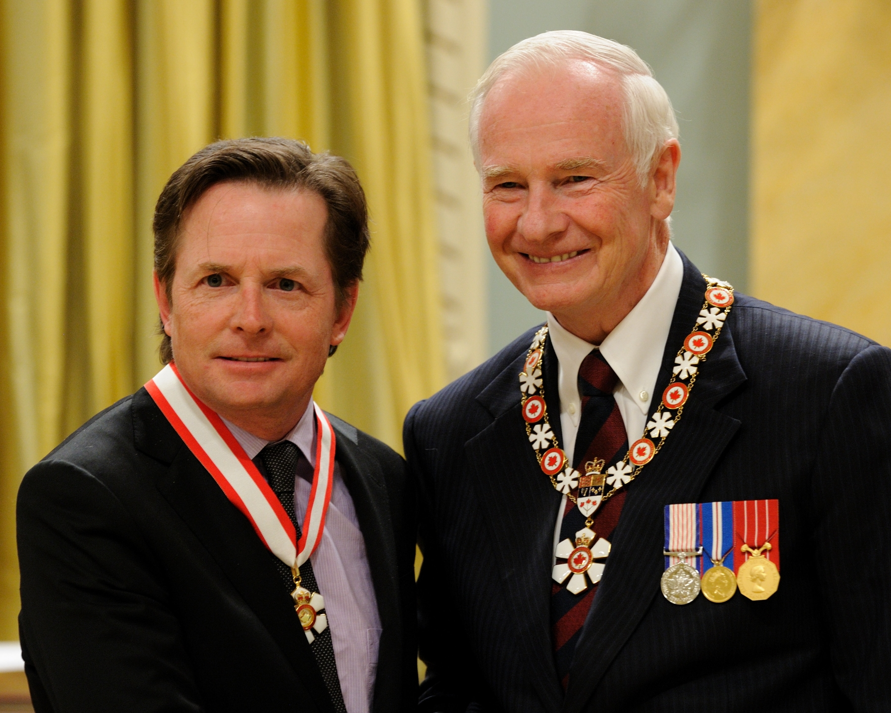 "Michael J. Fox (New York, New York, U.S.A. and Vancouver, British Columbia) is an outspoken advocate for people living with Parkinson's disease, as well as a respected and accomplished screen actor. He is best known for his work in the television series ""Family Ties"" and ""Spin City,"" and for the Back to the Future film trilogy. Diagnosed with Parkinson's disease in the early 1990s, he has focused his creative energies on funding medical research through the Michael J. Fox Foundation for Parkinson's Research. He continues to raise funds for the development of better treatments for patients. The Canadian branch of his foundation recently gained charitable status, ensuring the financial support of Canadian medical researchers working towards the ultimate goal of finding a cure."