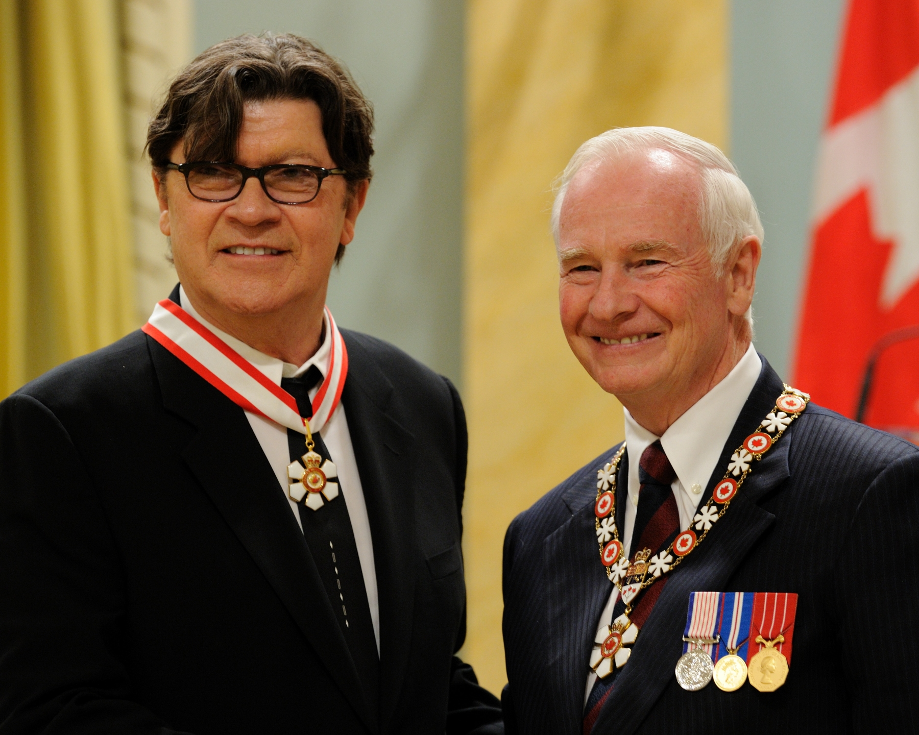 A rock music legend, Robbie Robertson (Los Angeles, California, U.S.A. and Toronto, Ontario) is one of Canada's most inspirational artists. He began his rise to stardom as a member of The Band, later embarking on a successful solo career that broadened to include film scores, acting, producing and musical collaborations. Through a fertile blending of diverse musical styles, he has introduced Native music to a much wider audience. His album Music for the Native Americans helped to showcase the work of other Native artists on the international music scene. By transcending cultural and geographical barriers, he stands as a model for both Aboriginal and non-Aboriginal artists alike.