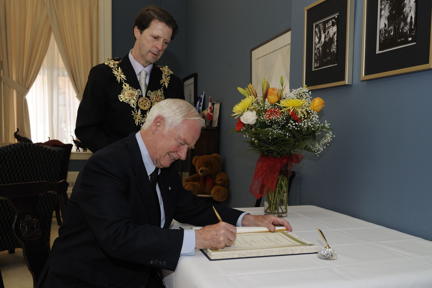 Prior to his meeting with the Mayor of Halifax, the Governor General signed the guest book.