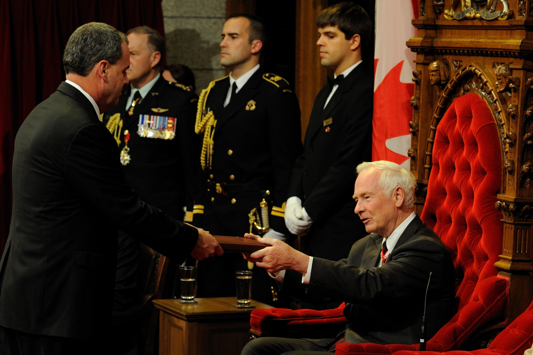 The Secretary to the Governor General Mr. Stephen Wallace gave the Speech from the Throne to His Excellency. The government of the day is Her Majesty's government and accordingly the Governor General, as the Queen's representative in Canada, reads the Speech from the Throne.
