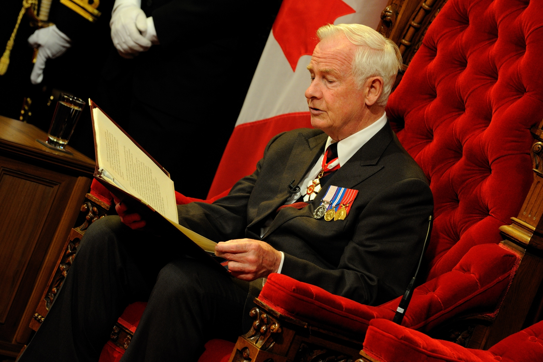 It is called the Speech from the Throne because the Governor General reads it while sitting in the seat in the Senate Chamber reserved for the Head of State or her representative, as the head of Canada's system of executive government. The Governor General reads the Speech to a gathering of Parliamentarians (Members of the House of Commons and Senators) and others, such as the Judges of the Supreme Court of Canada.