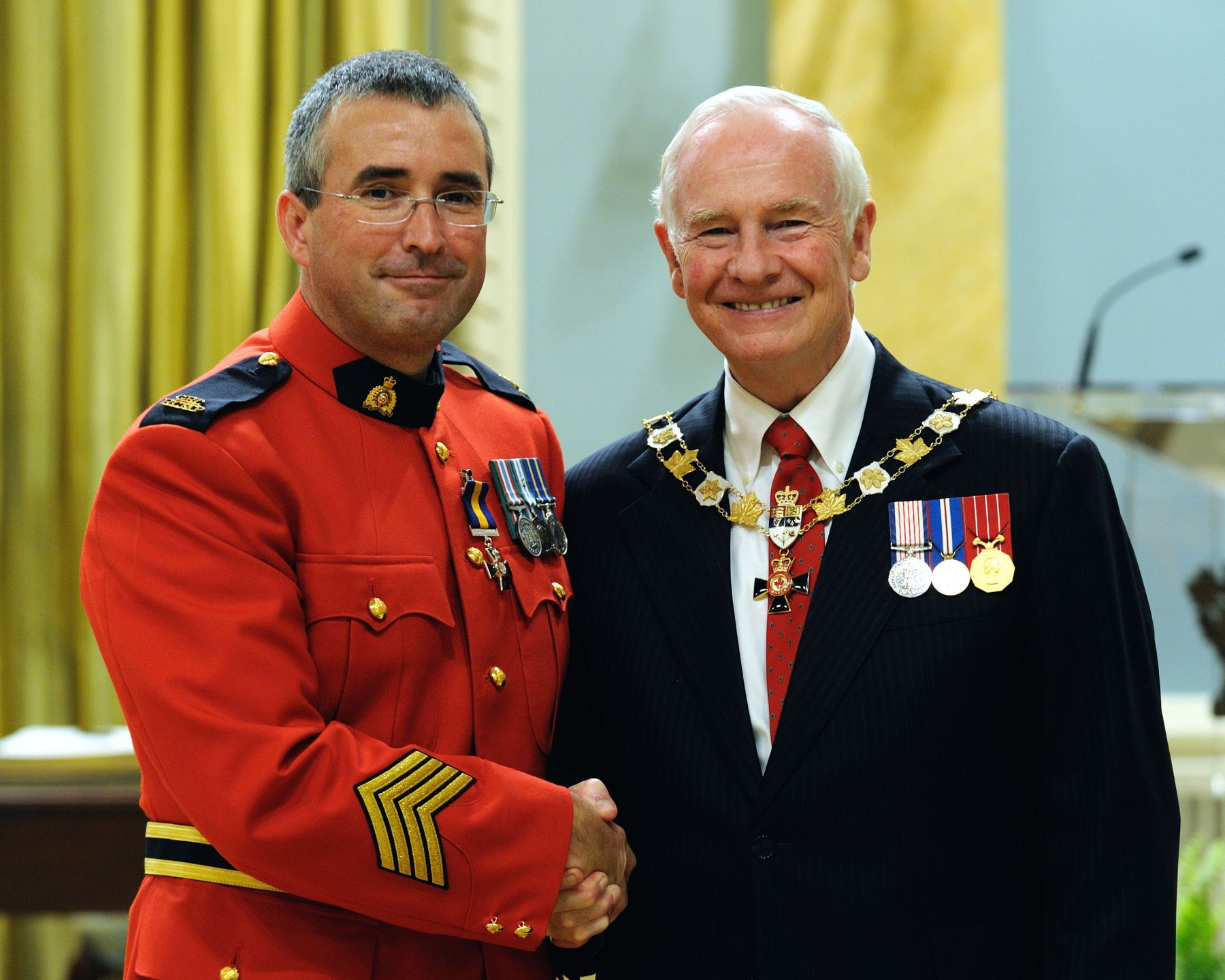 His Excellency presented the Order of Merit of the Police Forces at the Member level (M.O.M.) to Staff Sergeant Stéphane St-Jacques, M.O.M., of the Royal Canadian Mounted Police, Ottawa, Ontario.