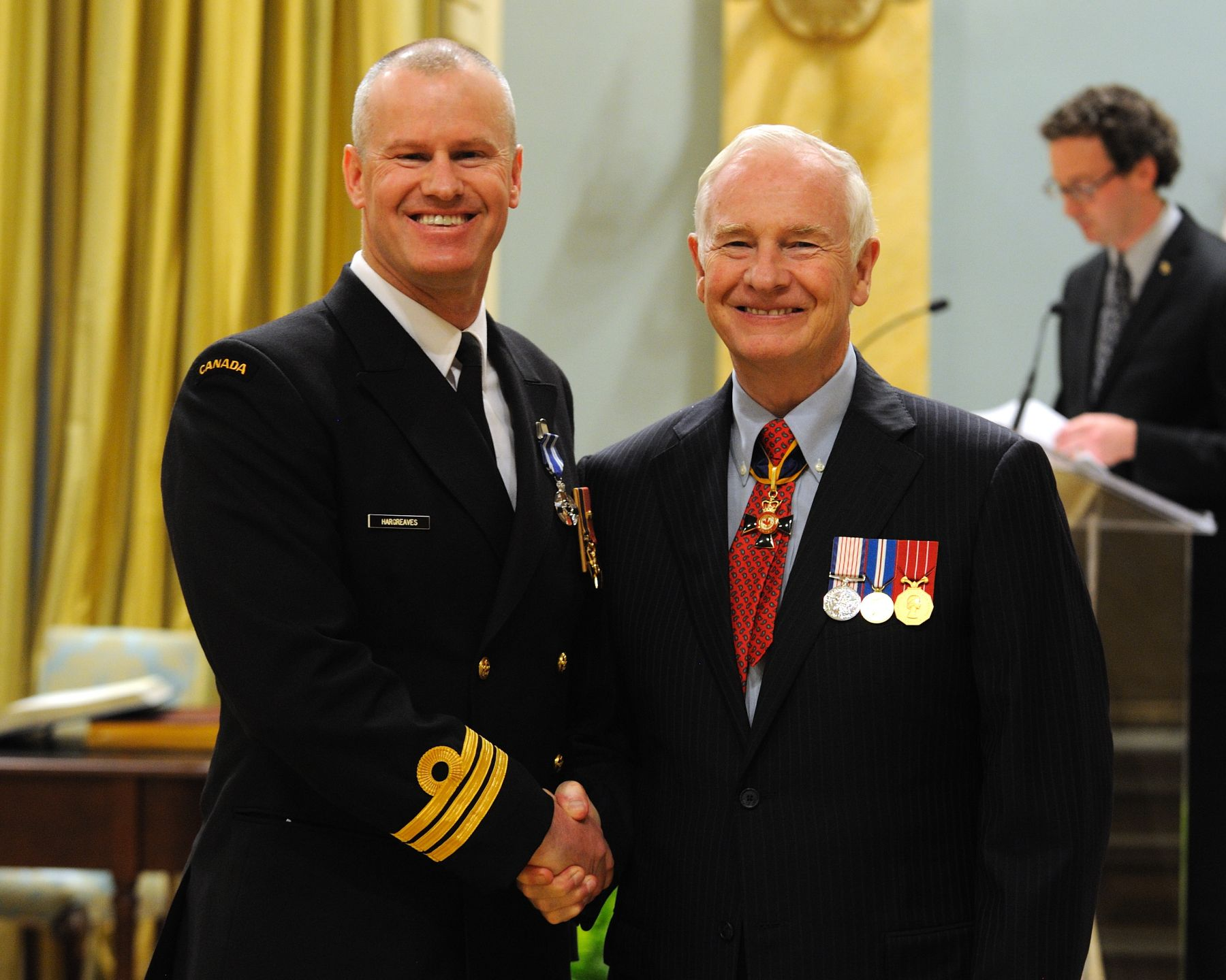 Commander Christopher John Hargreaves, O.M.M., M.S.M., C.D., received the Meritorious Service Medal (Military Division) from His Excellency. Since his appointment in 2008 as commanding officer of Canadian Forces Fleet School Esquimalt, Commander Hargreaves' inspirational leadership, detailed analytical skills, dedication and infectious motivation have been the driving force behind initiatives to improve naval courses. His actions were instrumental in enhancing the sailors' quality of life and reducing time away from home and units. His commitment and professionalism have had a significant impact on the individual training requirements for naval force employment, generation and development.