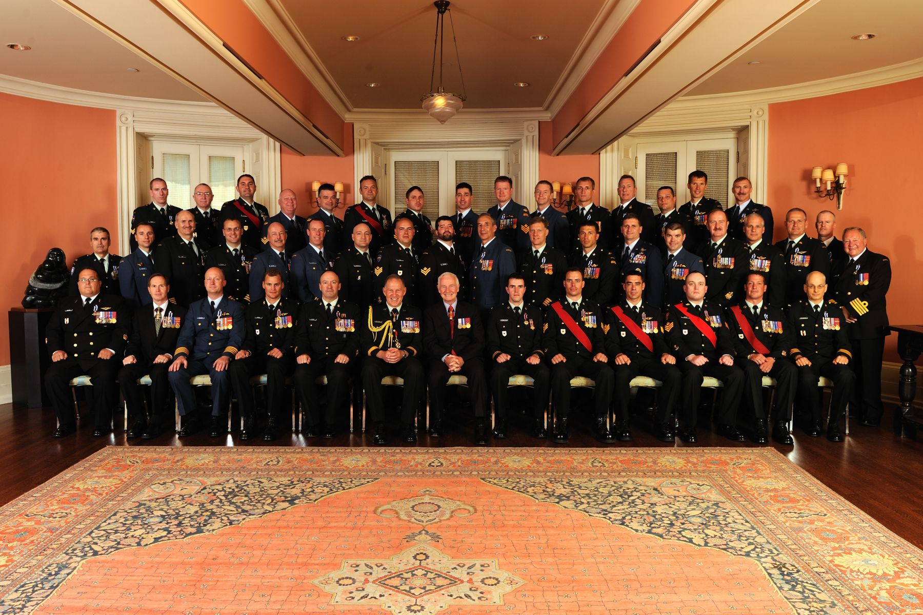 His Excellency and General Natynczyk are pictured with the 45 recipients who were presented with Military Valour and Meritorious Service Decorations.