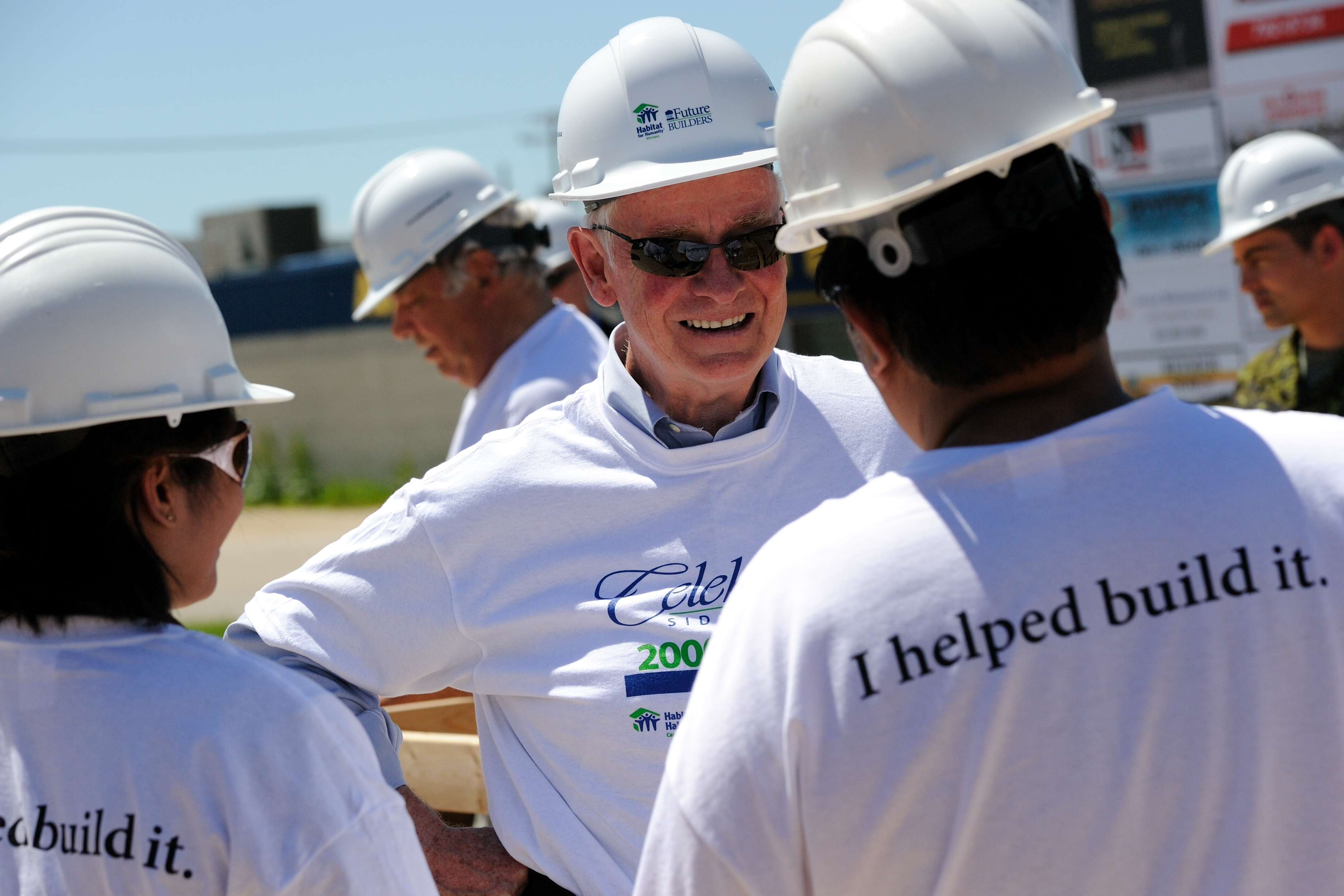 His Excellency meeting with the future owners of the 2000th Habitat for Humanity home, currently under construction.